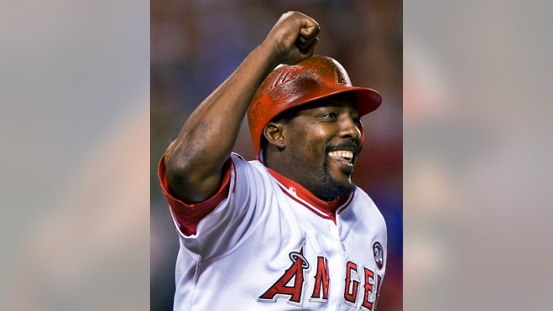 FILE - In this Aug. 10, 2009, file photo, Los Angeles Angels' Vladimir Guerrero celebrates hitting his 400th career home run in the seventh inning of a baseball game against the Tampa Bay Rays,  in Anaheim, Calif. Steroids-tainted stars Manny Ramirez and Ivan Rodriguez are on baseball's Hall of Fame ballot for the first time along with Vladimir Guerrero. (AP Photo/Mark Avery, File)