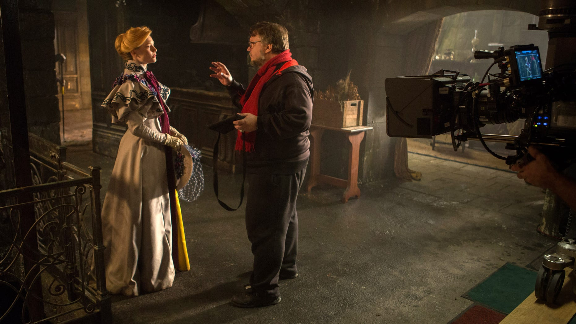 "Actress Mia Wasikowska with director Guillermo del Toro on the set of ""Crimson Peak."""