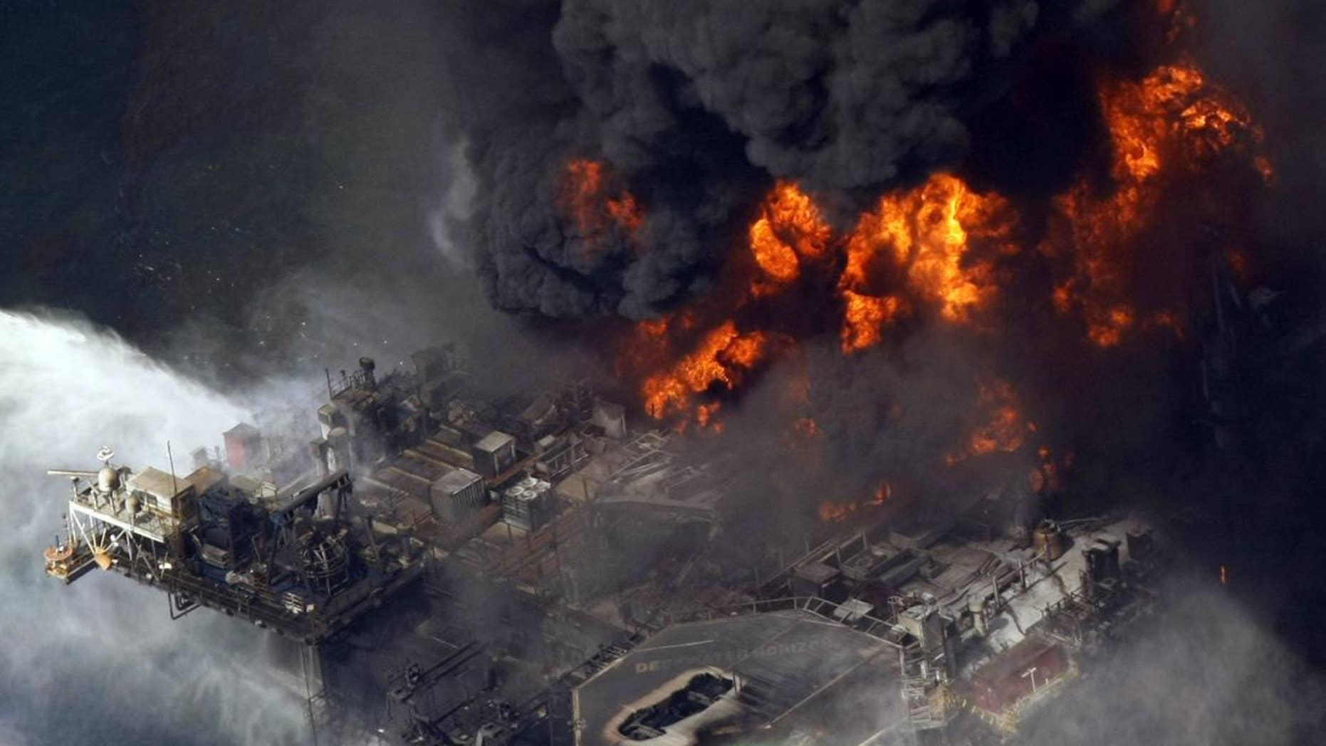 The Deepwater Horizon oil rig is seen burning on April 21, 2010.  (AP Photo/Gerald Herbert, File)