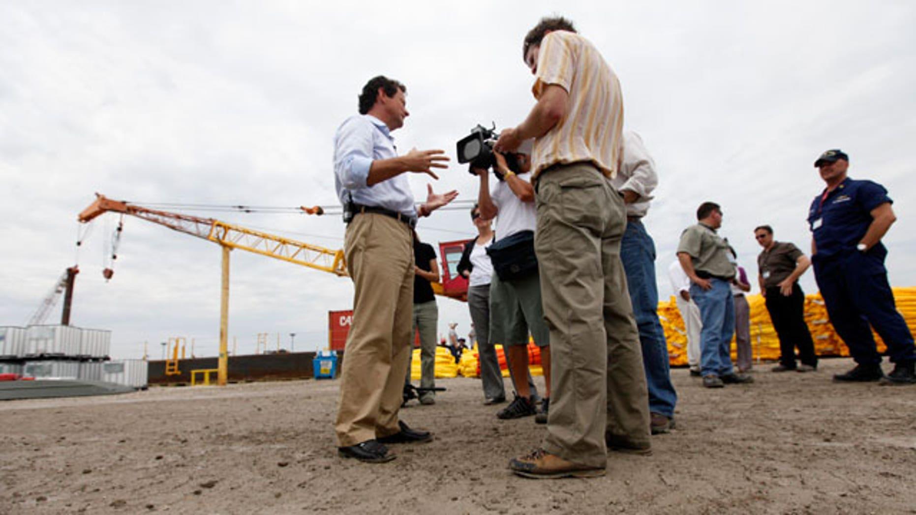 BP PLC CEO Tony Hayward talks to reporters as he visits a Coast Guard command center in Venice, La., Sunday, May 30, 2010.