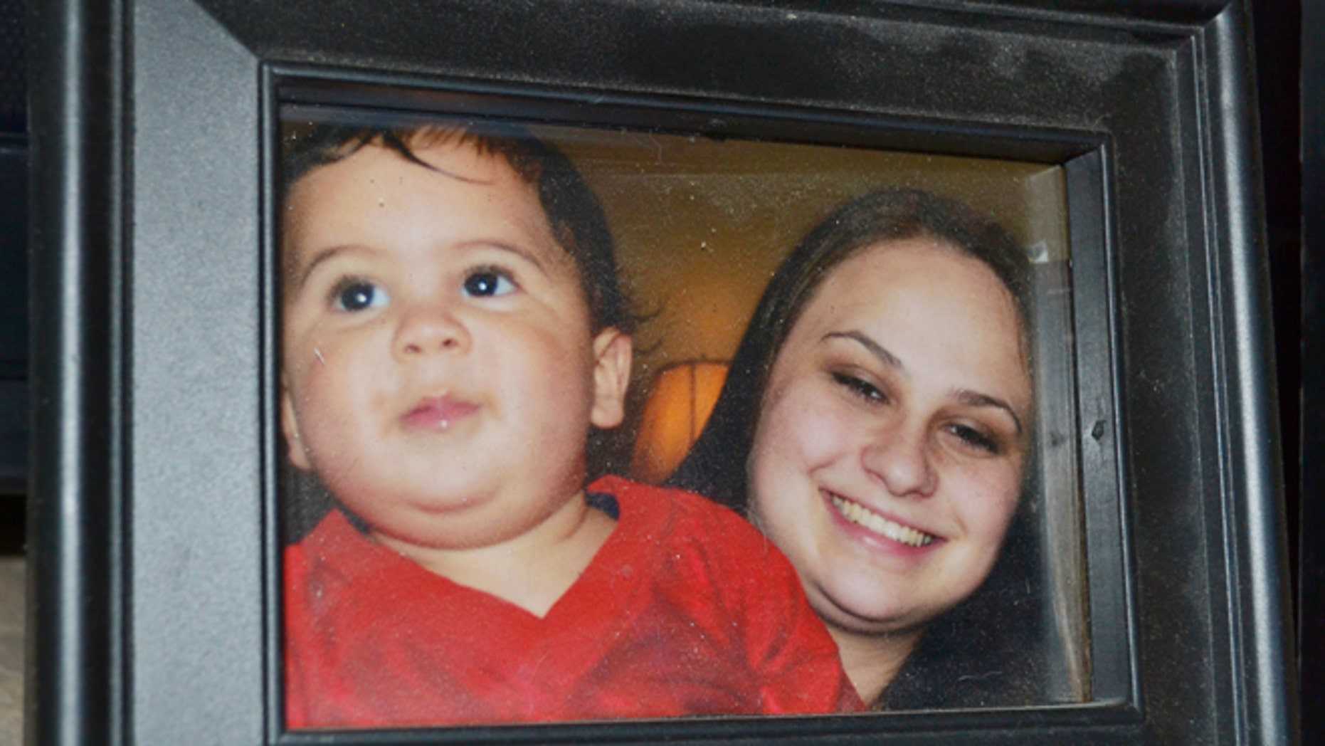 Photo provided by the family shows Bryson Mees-Hernandez, 9 months, with his mother, Crystal Mees, in Houston.