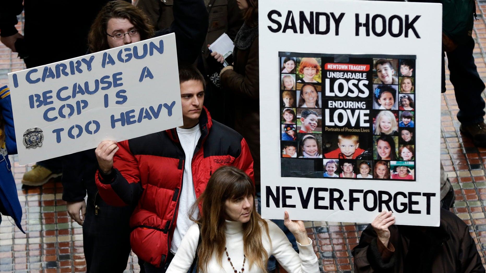 Jan. 23, 2013: Gun rights and gun control advocates demonstrate in the Pennsylvania Capital building  in Harrisburg, Pa.