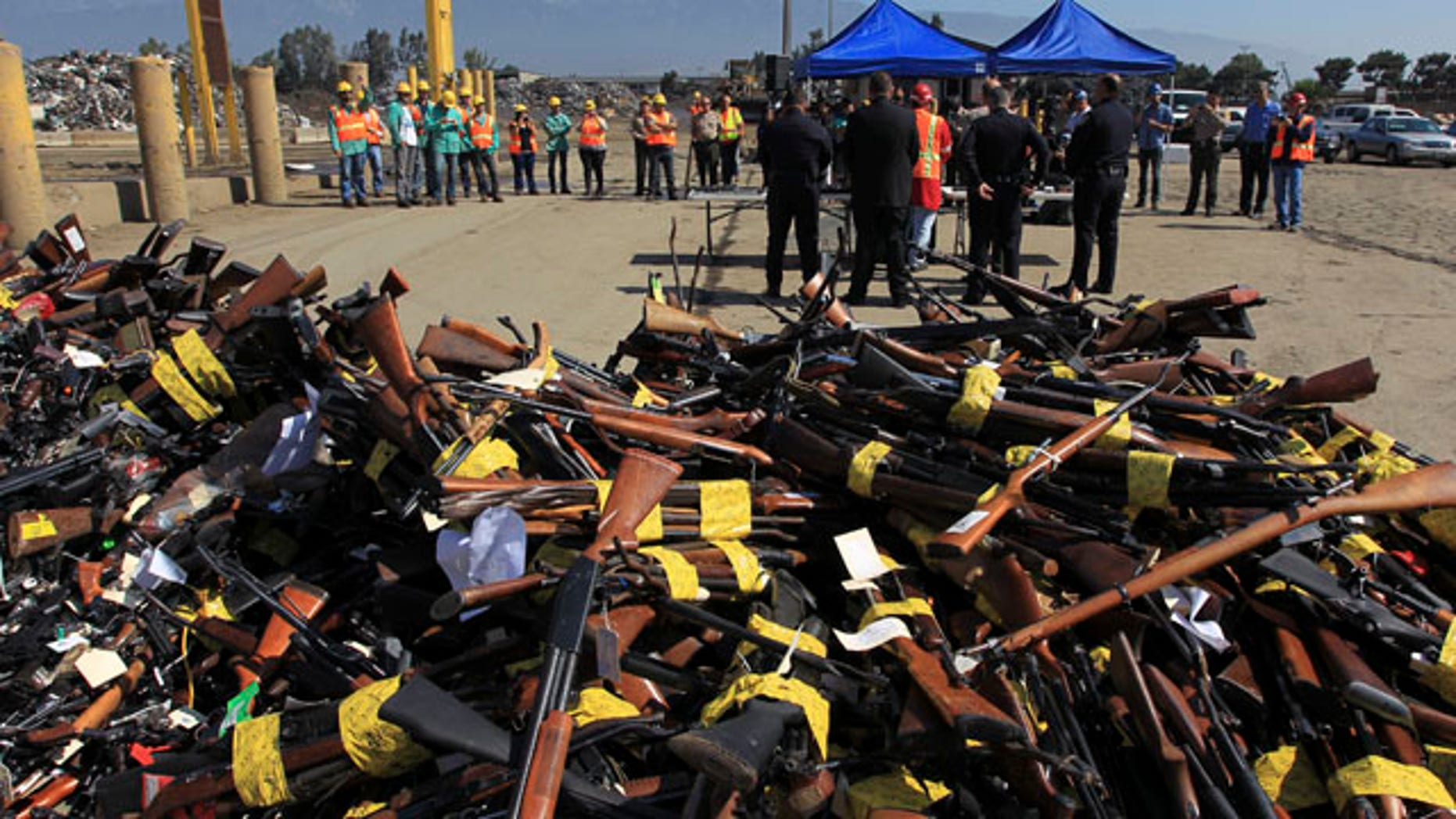 July 30, 2013: Guns to be melted lie in a pile near a news conference at the Los Angeles County Sheriff's Department's 20th annual Gun Melt at the Gerdau Steel Mill in Rancho Cucamonga, California.