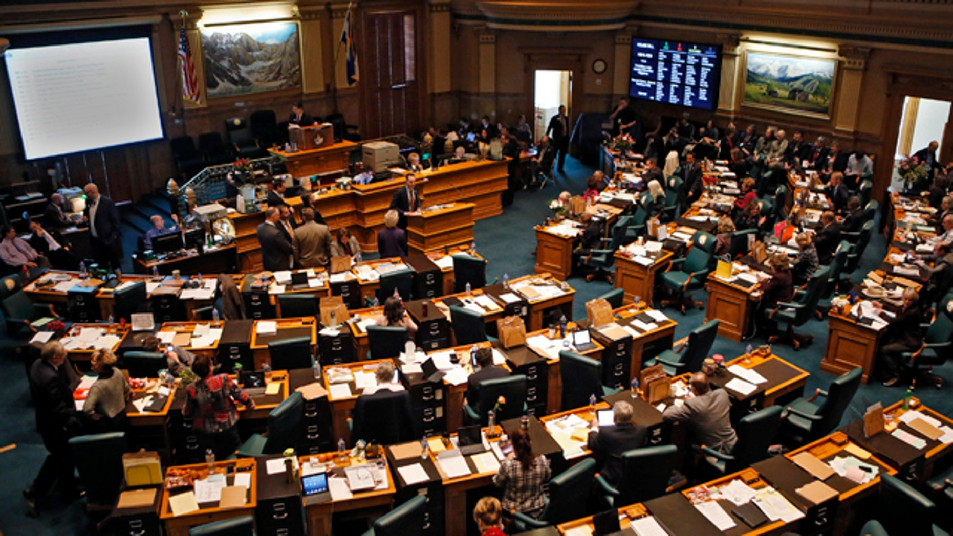 Feb. 15, 2013: Colorado House members gather in their Chamber at the Capitol in Denver.