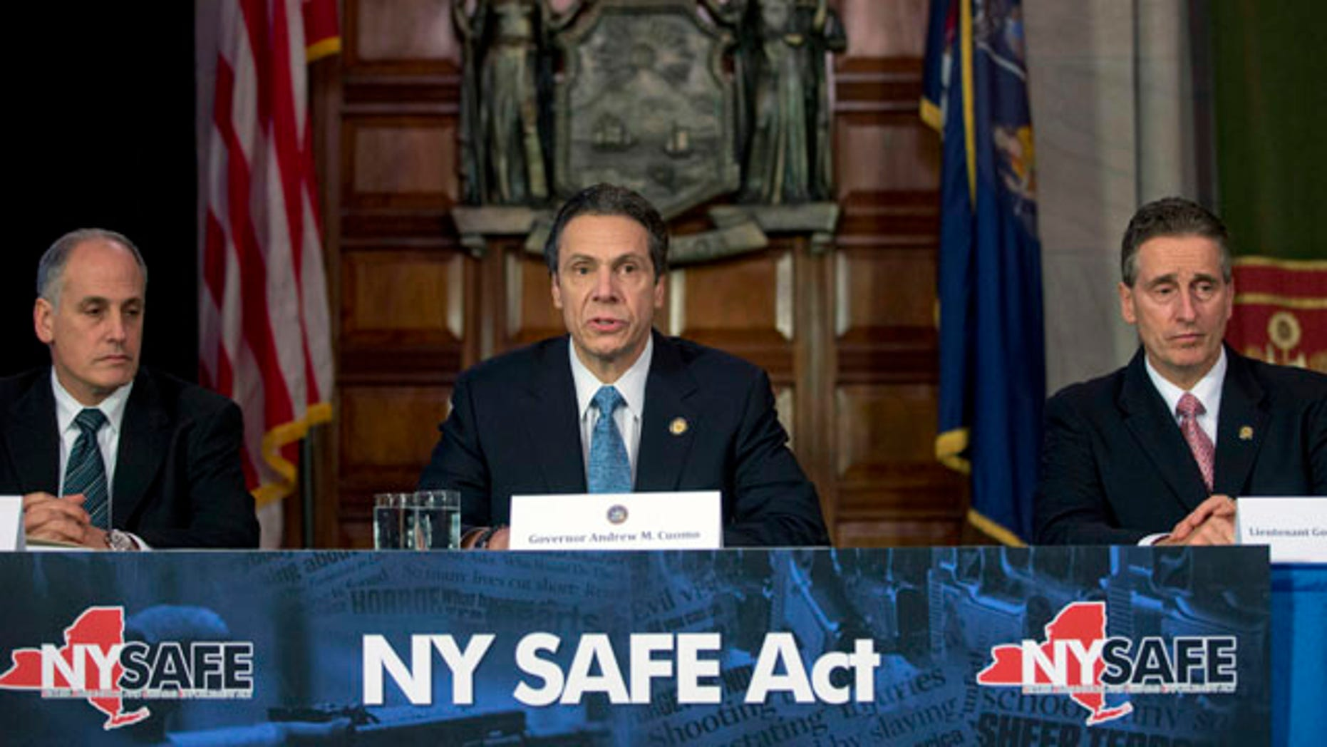 Jan. 14, 2013: New York Gov. Andrew Cuomo, center, speaks during a news conference announcing an agreement with legislative leaders on New York's Secure Ammunition and Firearms Enforcement Act in the Red Room at the Capitol.
