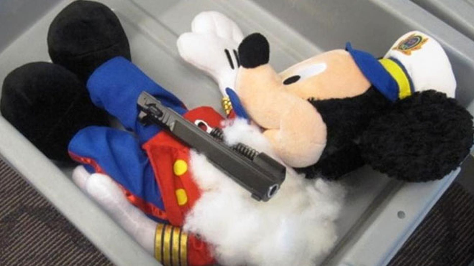 This undated photo provided by the federal Transportation Security Administration shows pistol parts hidden in a stuffed animal found by TSA officials at T.F. Green Airport in Warwick, R.I., Monday May 7, 2012.