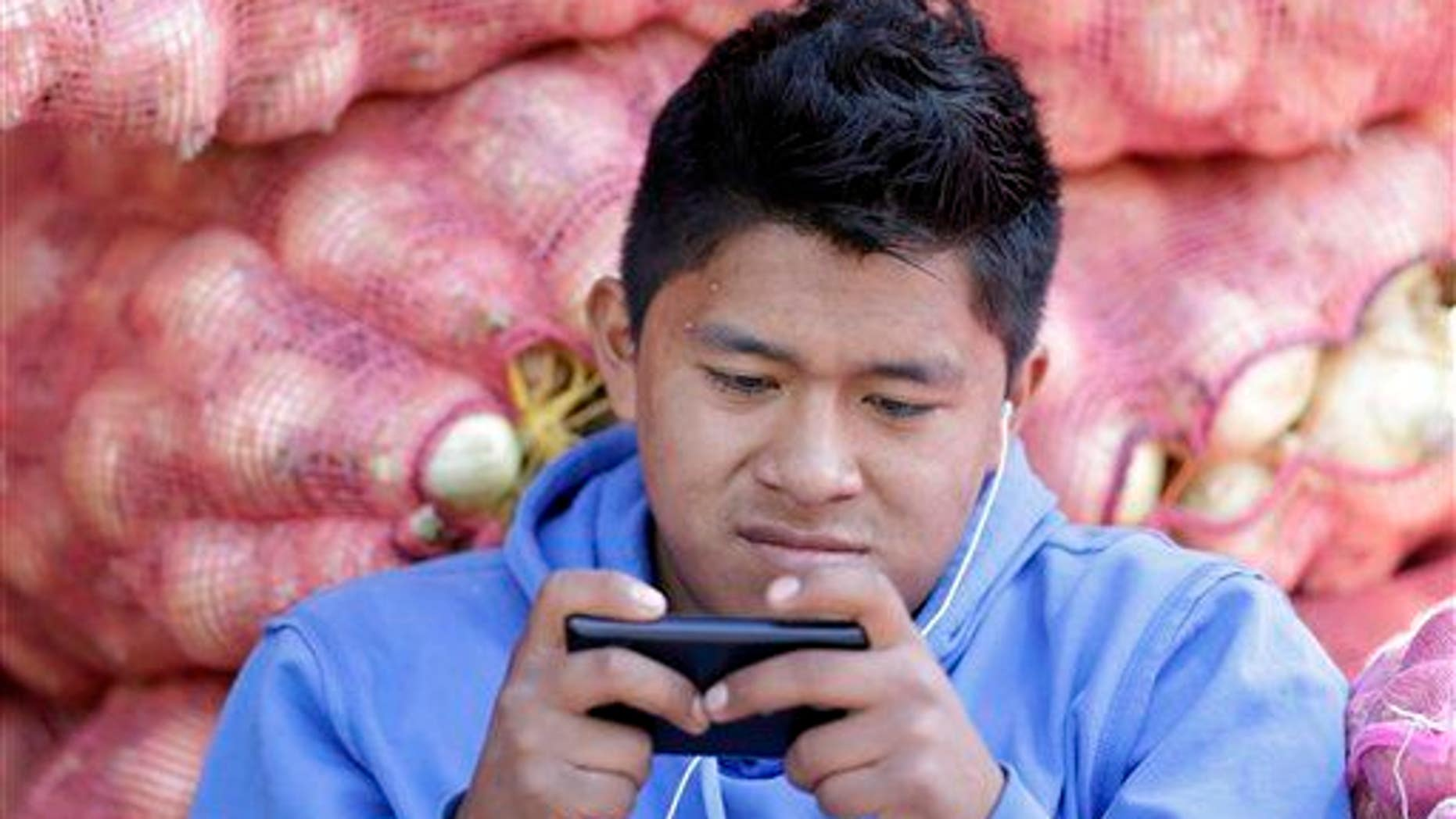 File photo of a man texting.