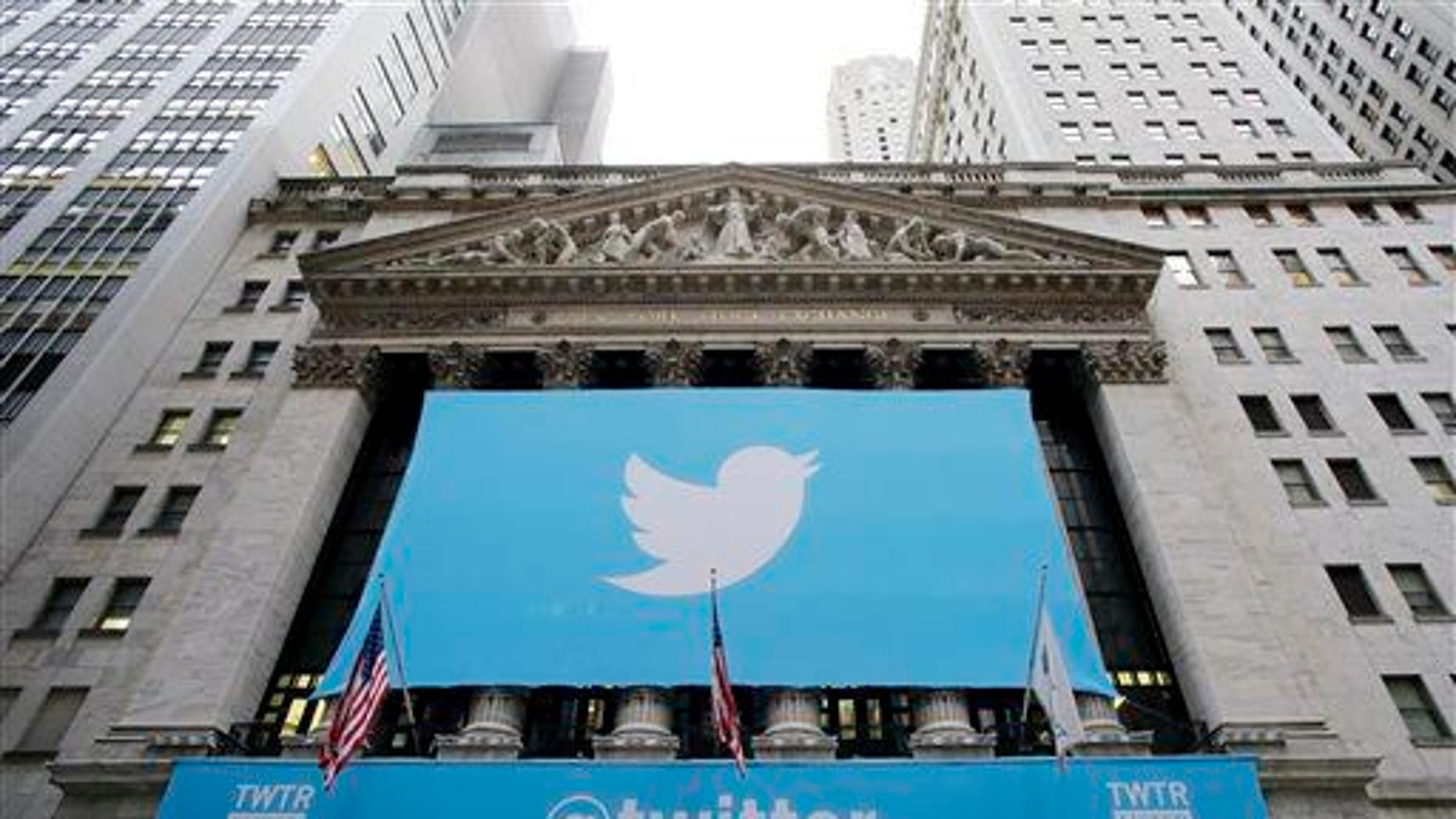 In this Thursday, Nov. 7, 2013 file photo, a banner with the Twitter logo hangs on the facade of the New York Stock Exchange.