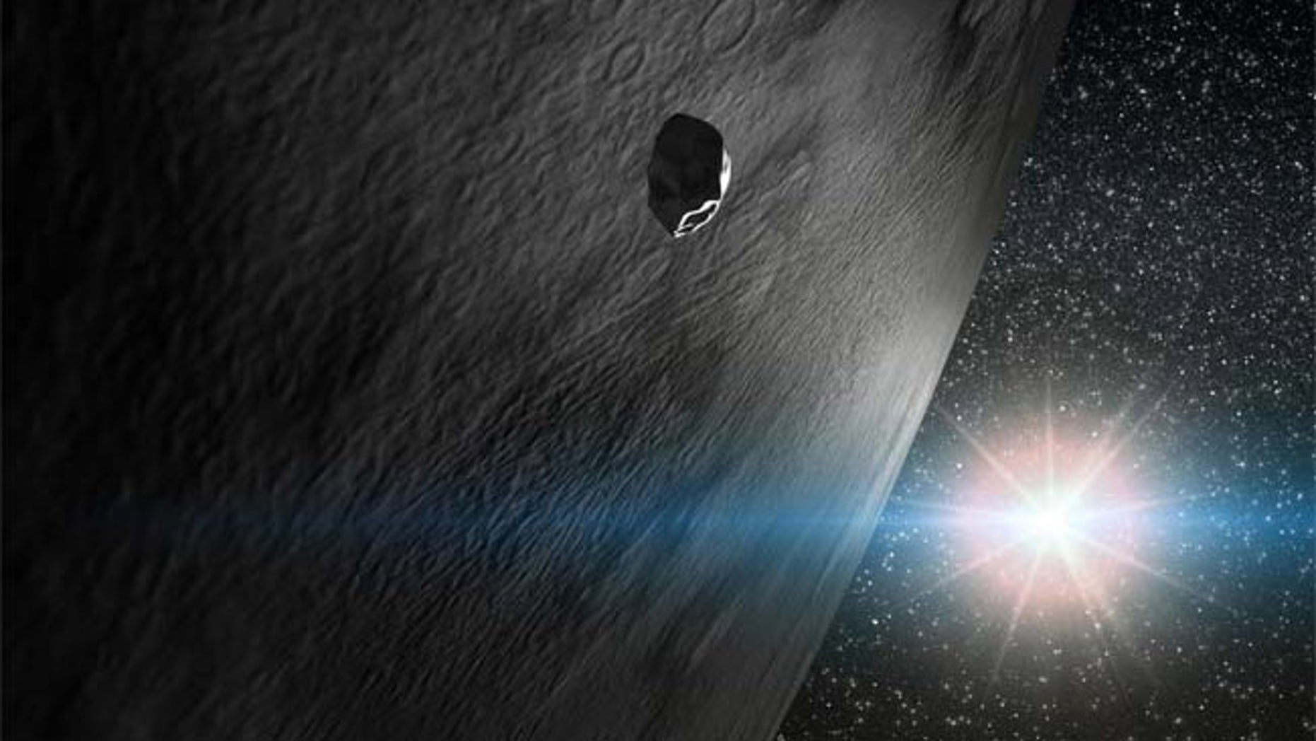 An illustration of the asteroid 24 Themis along with two small fragments that orbit with it. One of the small fragments is inert (as most asteroids are) and the other has a comet-like tail.