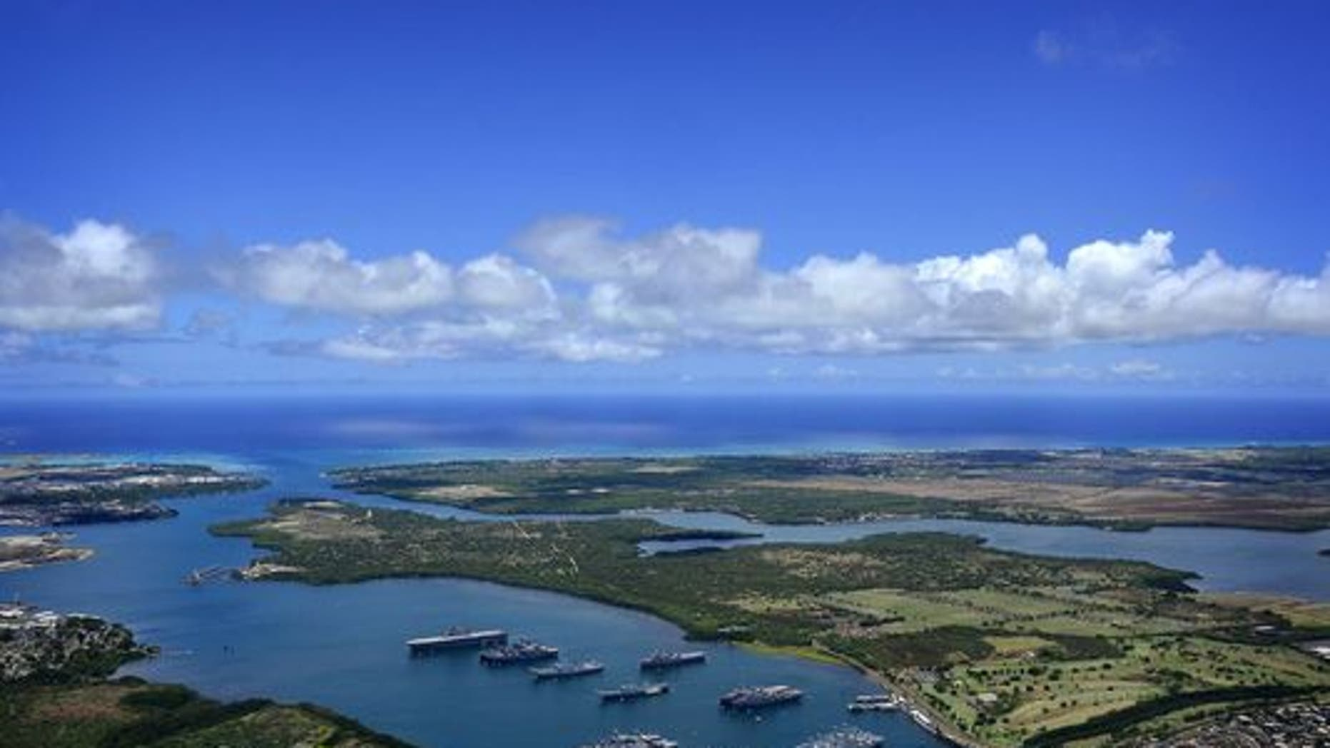 Navy ships are anchored in the waters of Joint Base Pearl Harbor-Hickam on July 14, 2011, at the entrance to the Pacific Ocean. (Credit: MC2 Daniel Barker/Navy)