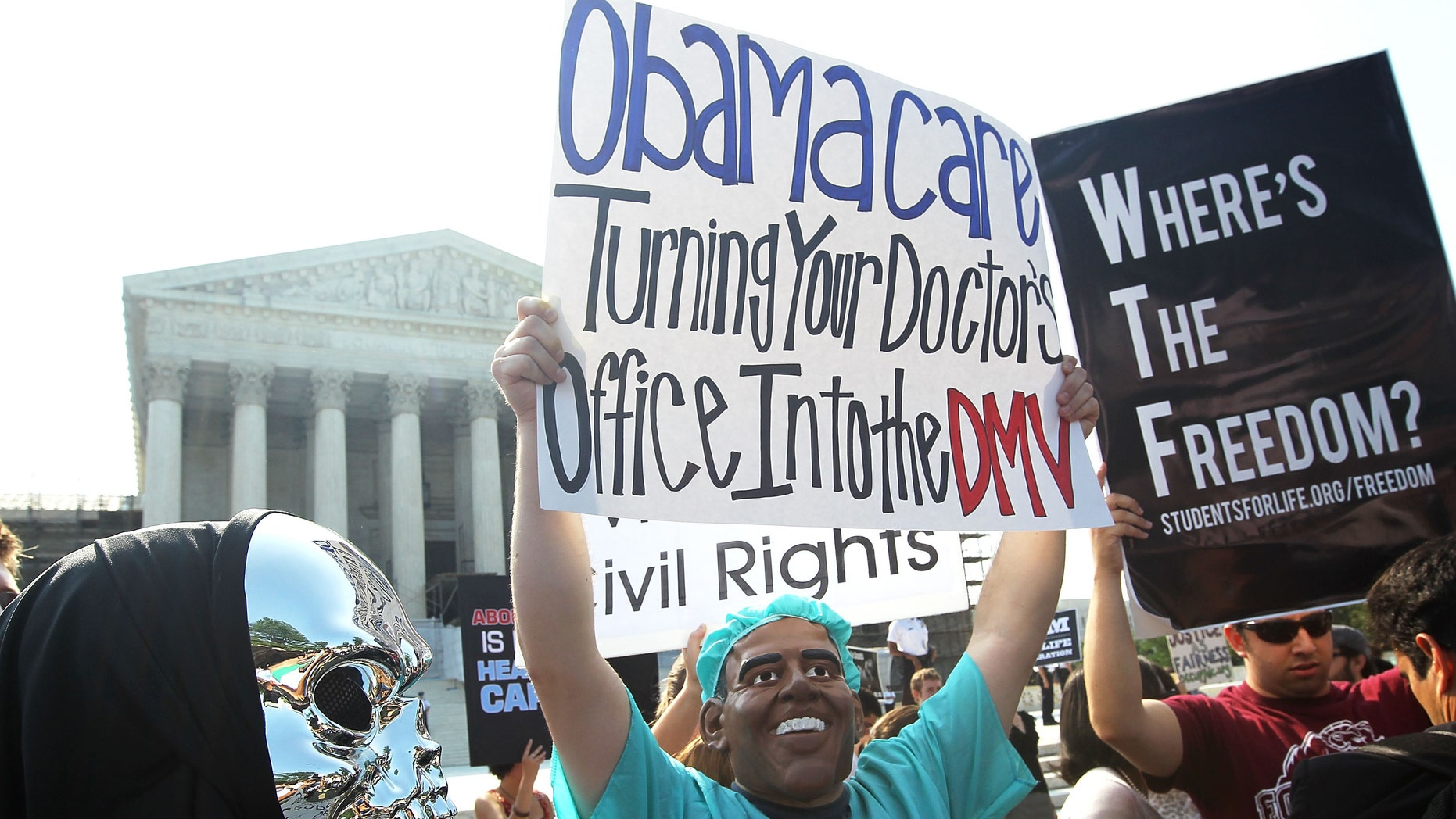 WASHINGTON, DC - JUNE 28:  Anti-Obamacare protesters wear masks of U.S. President Barack Obama and Grim Reaper as they demonstrate in front of the U.S. Supreme Court June 28, 2012 in Washington, DC. The Supreme Court is expected to hand down its ruling on the Affordable Healthcare Act this morning.  (Photo by Alex Wong/Getty Images)
