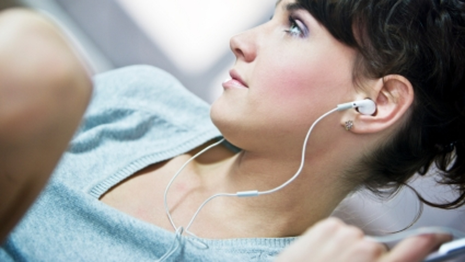 Woman listening music, selective focus, canon 1Ds mark III