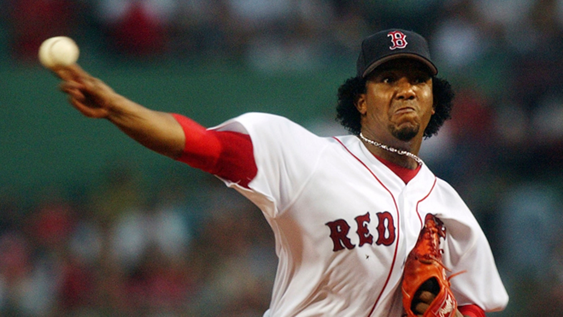FILE - In this June 25, 2004 file photo, Boston Red Sox starting pitcher Pedro Martinez delivers during the first inning of a Major League baseball game against the Philadelphia Phillies at Fenway Park in Boston. Martinez is among among 17 first-time candidates on the 2015 Baseball Hall of Fame ballot. (AP Photo/Charles Krupa, File)