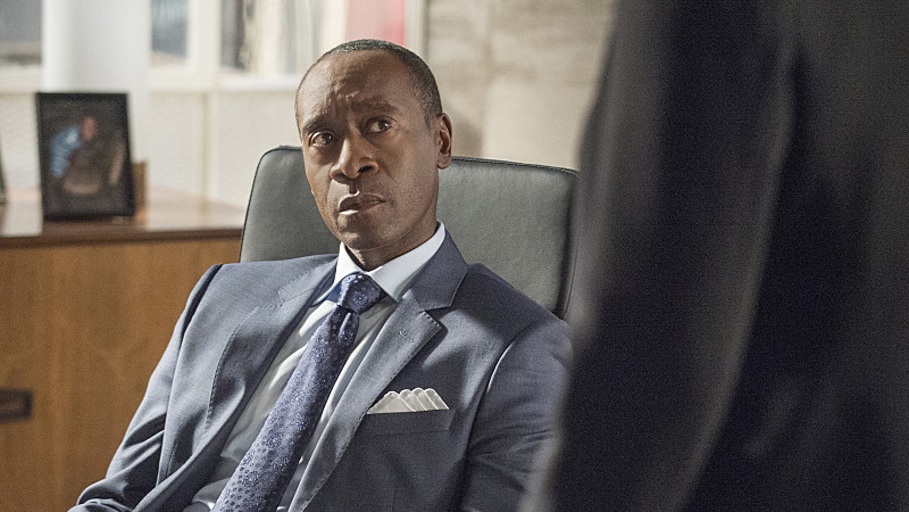 Don Cheadle as Marty Kaan in House of Lies