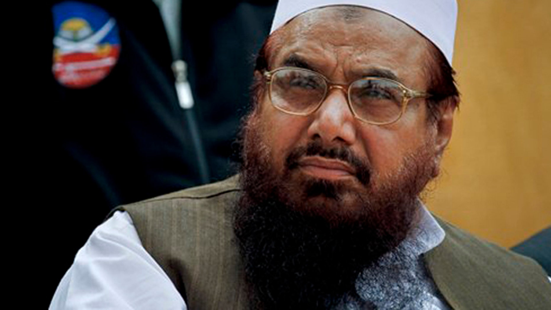 FILE - Lashkar-e-Taiba founder Hafiz Saeed, attends a ceremony in Islamabad, Pakistan.