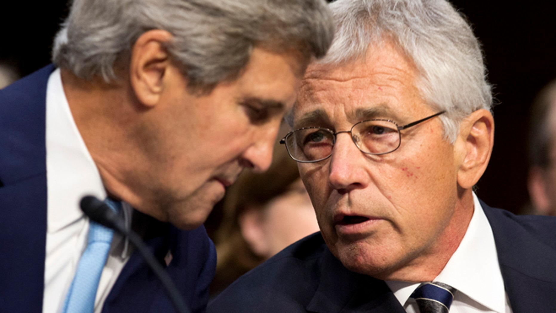 """Sept. 3: From the left, U.S. Secretary of State John Kerry and Secretary of Defense Chuck Hagel speak on Syria in front of the Senate Foreign Relations Committee. Hagel warned the committee """"a massive stockpile of chemical weapons that threatens our treaty ally, the  Republic of Korea, and the 28,000 U.S. troops stationed there."""""""