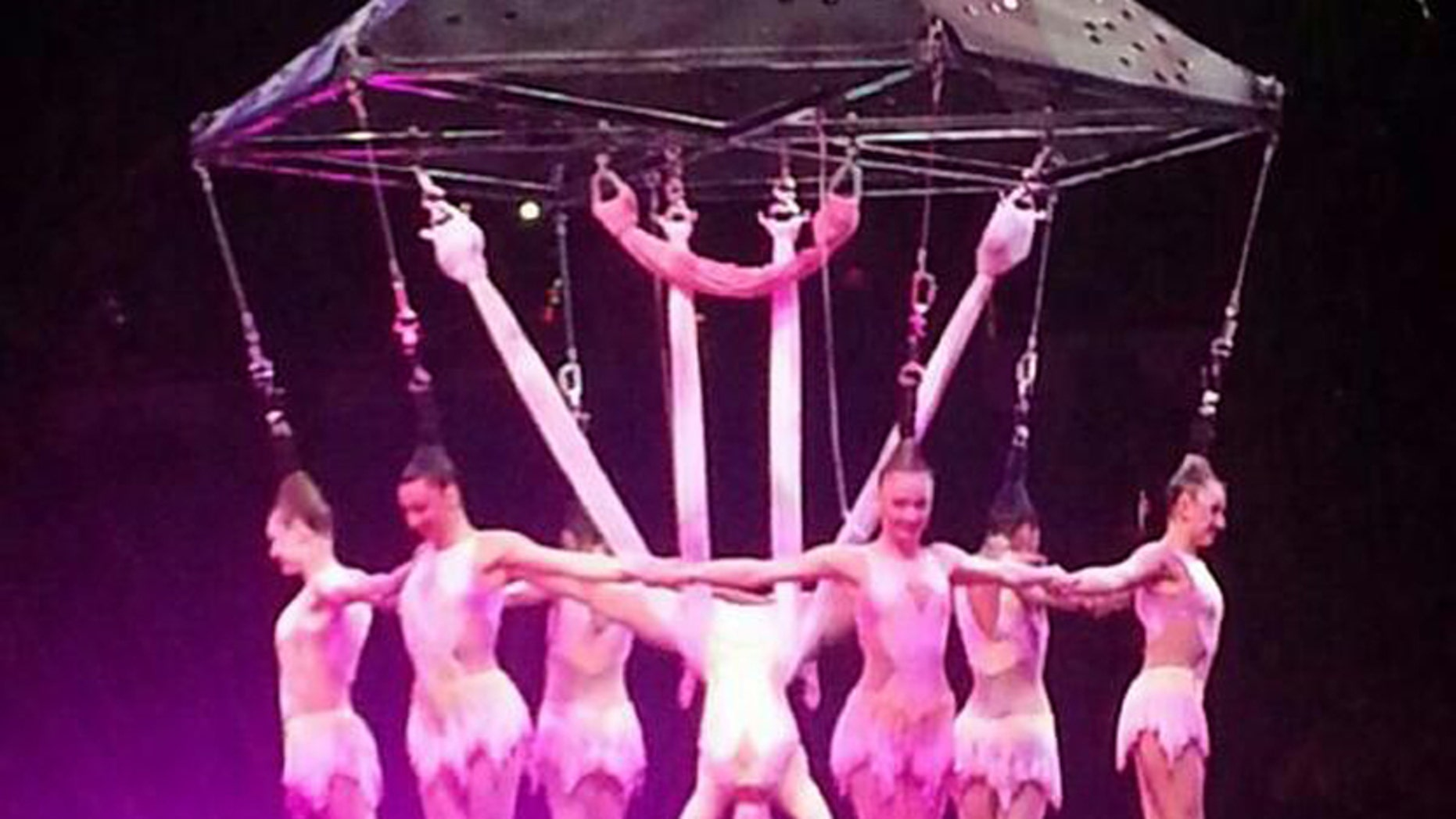 In this photo provided by Frank Caprio, performers hang during an aerial hair-hanging stunt at the Ringling Brothers and Barnum and Bailey Circus, Friday, May 2, 2014, in Providence, R.I. A platform collapsed during an aerial hair-hanging stunt at the 11 a.m. performance Sunday, May 4, sending eight acrobats plummeting to the ground. At least nine performers were seriously injured in the fall, including a dancer below, while an unknown number of others suffered minor injuries. (AP Photo/Frank Caprio) MANDATORY CREDIT