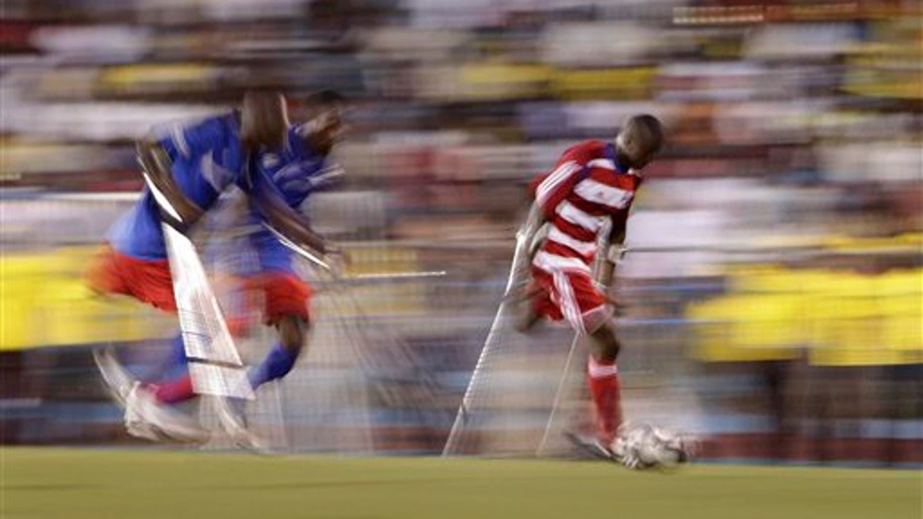 Jan. 10, 2011: A player belonging to Haiti's unofficial national amputee soccer team, right, controls the ball as two players from the local Zaryen team attempt to defend in a friendly match at the national stadium in Port-au-Prince, Haiti. The game is one of many events planned to mark the one-year anniversary of the Jan. 12th magnitude-7.0 quake that killed more than 220,000 people and left millions homeless.  Many of the players from both teams lost their limbs in the earthquake. (AP)