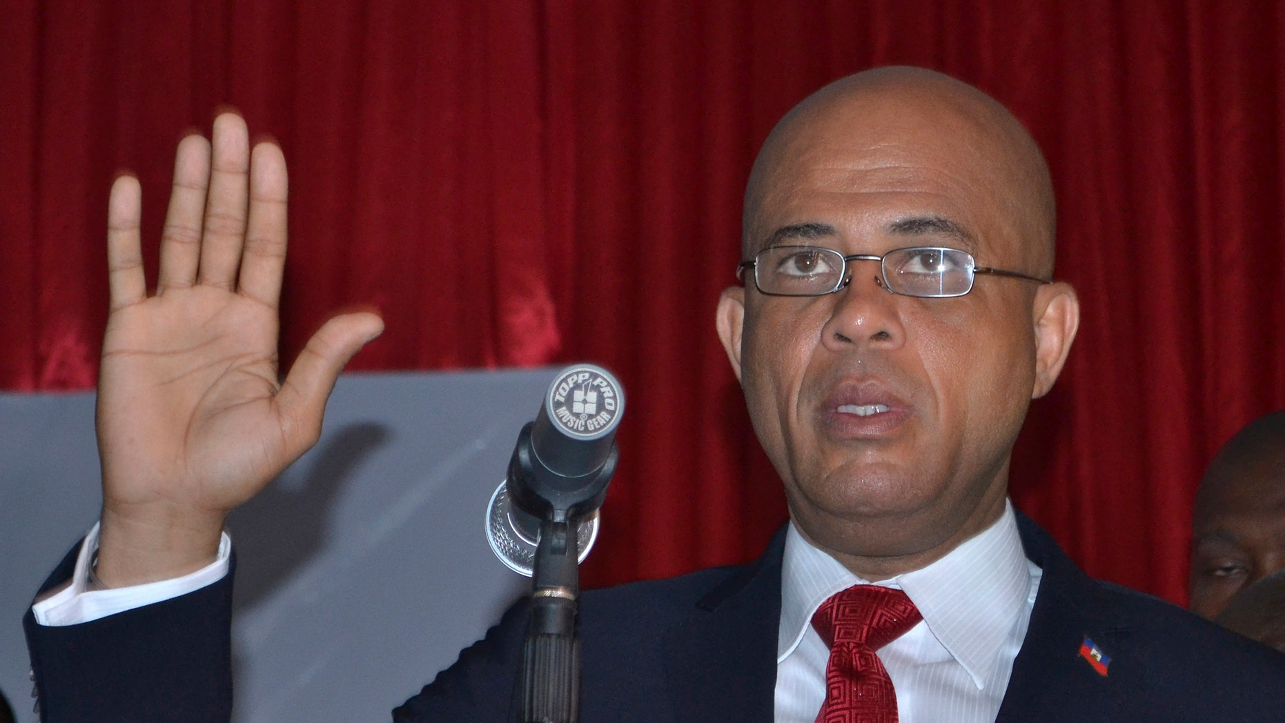 """Michel Martelly is sworn in as Haiti's new president inside a Haitian Parliamentary meeting room in Port-au-Prince, Haiti, Saturday May 14, 2011. Martelly, better known as the popular singer """"Sweet Mickey, defeated his closest rival former, first lady Mirlande Manigat, in a landslide victory with 67.5 percent of the vote in the runoff elections held on March 20th."""