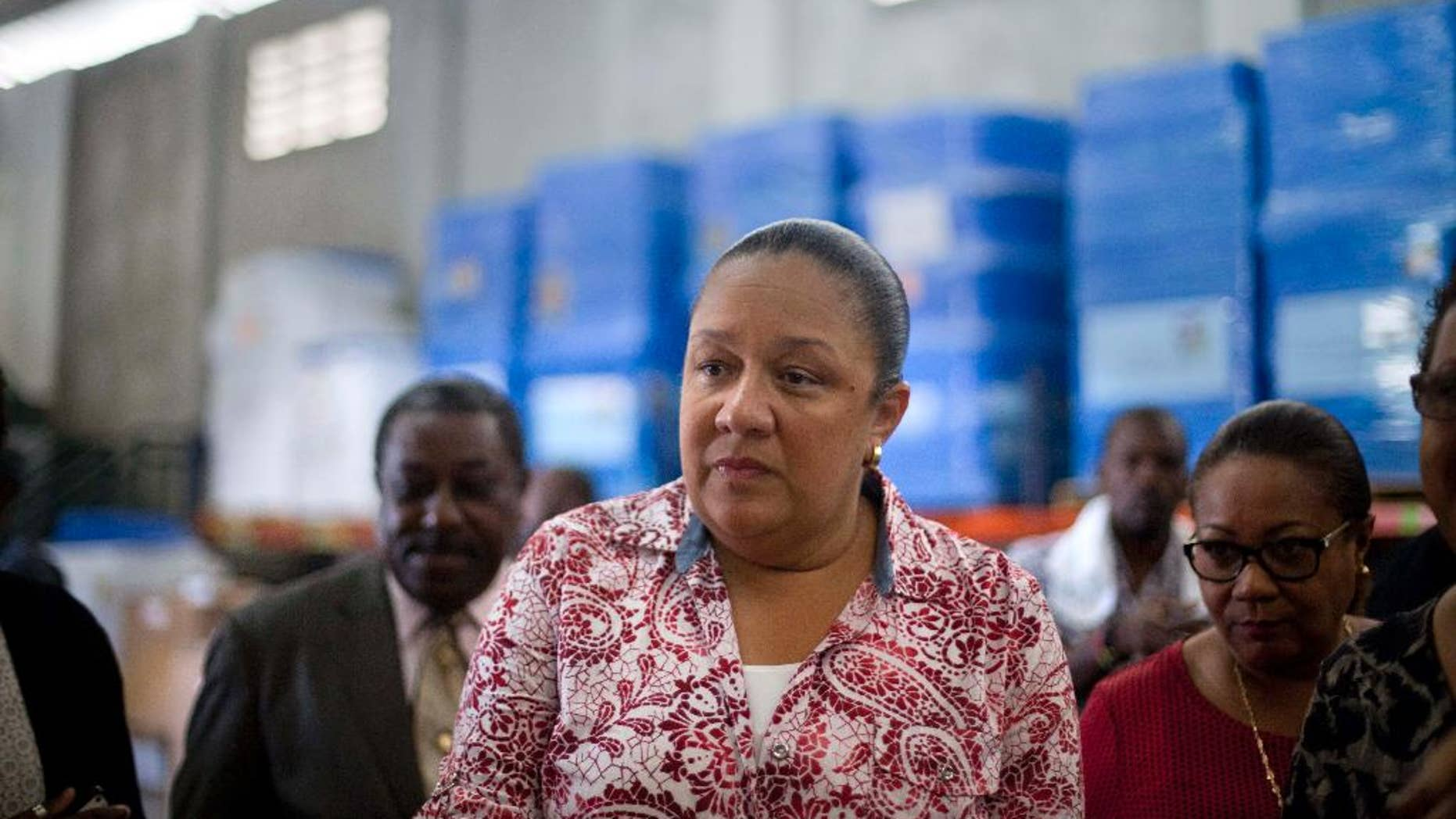 FILE - In this Sept. 10, 2014, file photo, Haiti's first lady Sophia Martelly visits a warehouse housing a donation of kits to treat chikungunya, in the Cite Soleil slum, in Port-au-Prince, Haiti.  An elections committee in Haiti has the rejected first lady's bid to run for Senate. Electoral council spokesman Richardson Dumel said Wednesday, May 13, 2015, that the committee would not allow the wife of President Michel Martelly to pursue her candidacy. He did not provide details about the decision. (AP Photo/Dieu Nalio Chery, File)