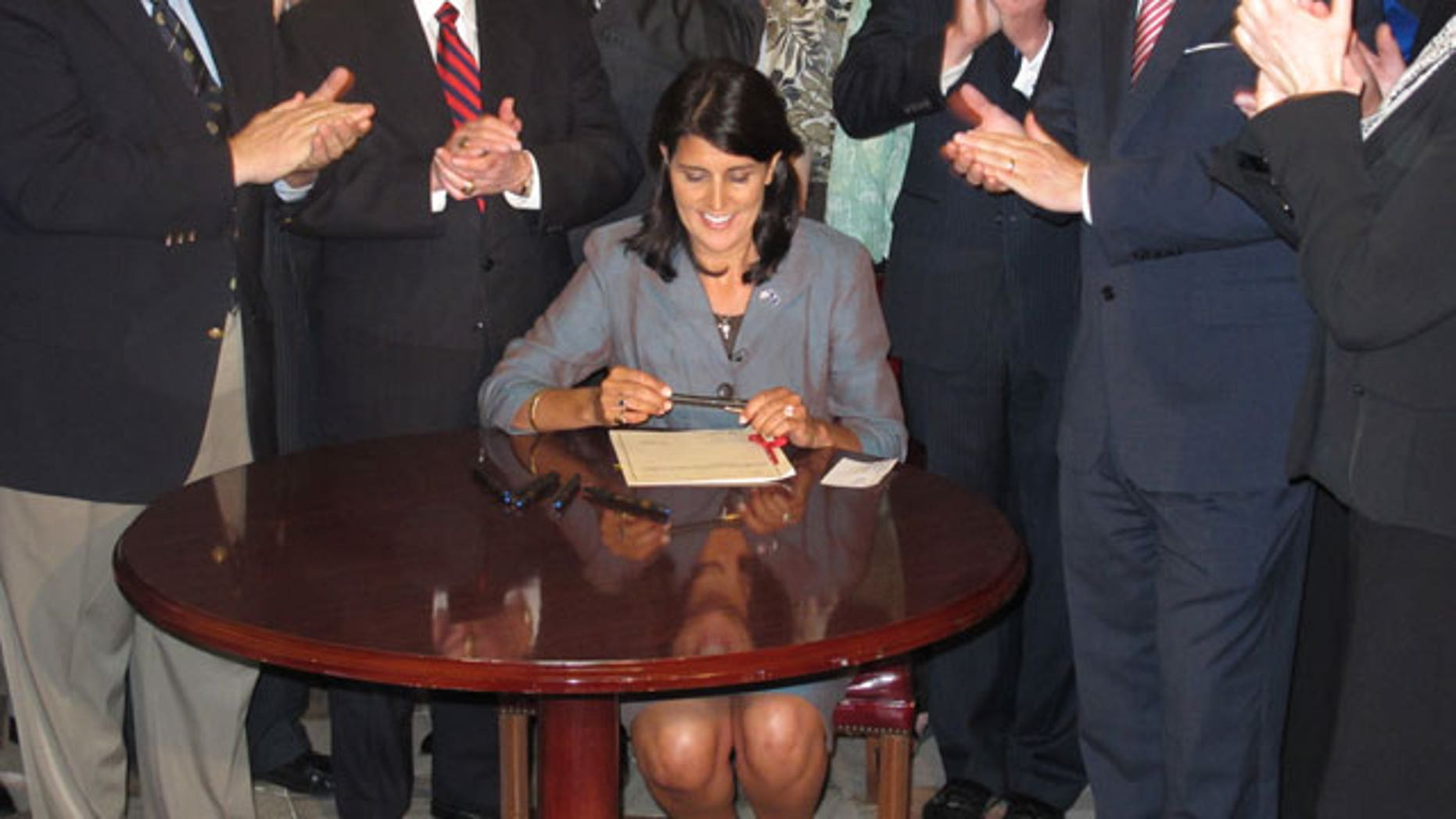 South Carolina Gov. Nikki Haley signs a bill that requires the state's General Assembly to record all its votes on budget items and final votes on other legislative matters, April 12,2011. (FNC)
