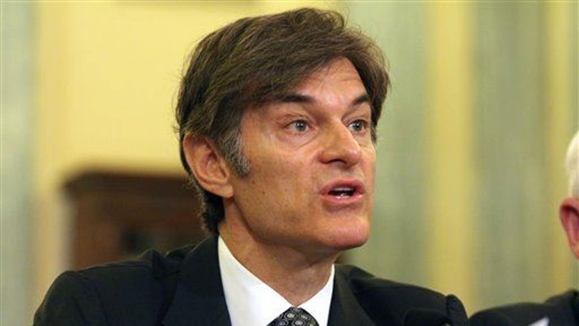 Dr. Mehmet C. Oz, chairman and professor of surgery, Columbia University College of Physicians and Surgeons, testifies on Capitol Hill on June 17, 2014, before a Senate subcommittee.