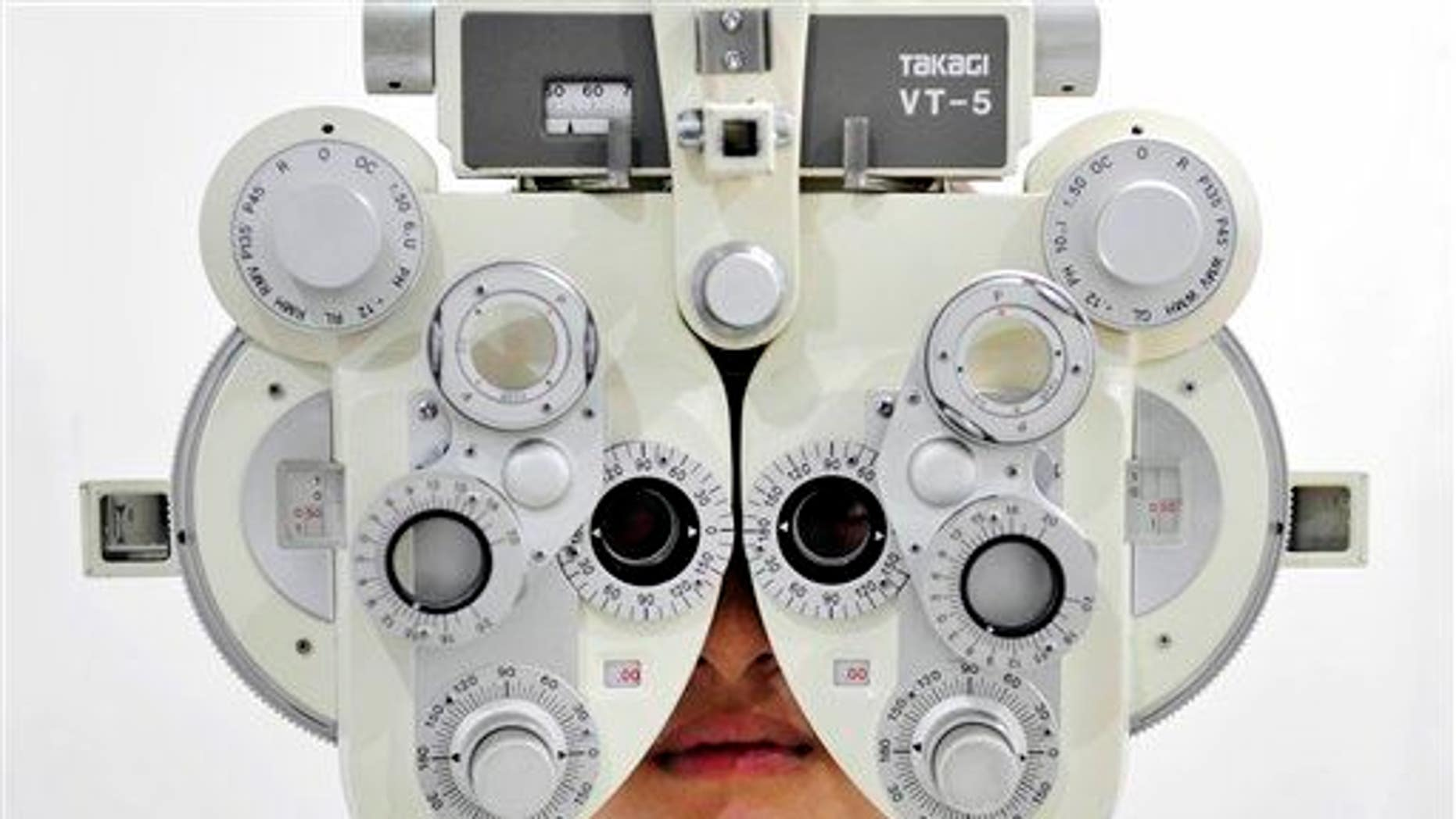 A near-sighted girl receives an eye sight examination.