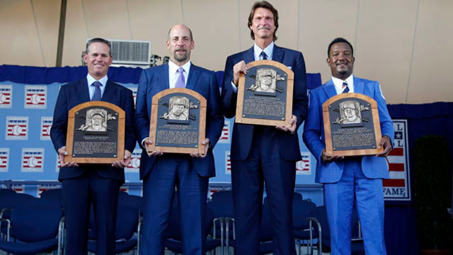 July 26, 2015: Newly-inducted National Baseball Hall of Famers from left to right, Craig Biggio, John Smoltz, Randy Johnson and Pedro Martinez hold their plaques after an induction ceremony at the Clark Sports Center, in Cooperstown, N.Y. (AP Photo/Mike Groll)