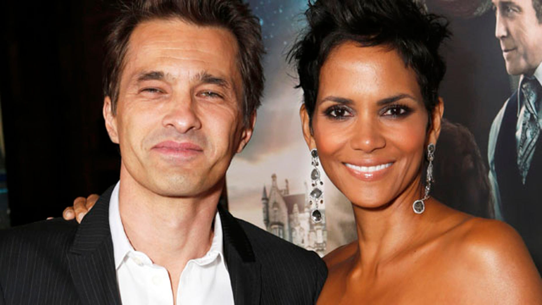 """Actors Olivier Martinez, left, and Halle Berry at the Los Angeles premiere of Berry's film, """"Cloud Atlas,"""" in the Hollywood section of Los Angeles."""