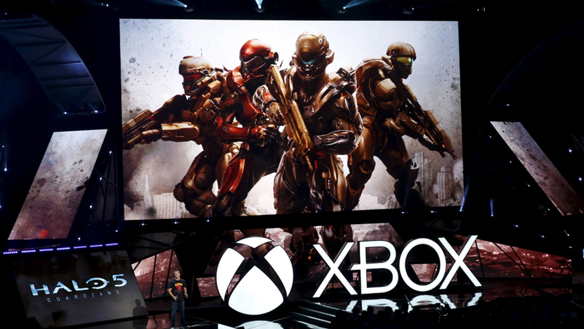 "Josh Holmes, executive producer at 343 Industries, introduces the ""Halo 5: Guardians"" video game during game publisher Microsoft's Xbox media briefing before the opening day of the Electronic Entertainment Expo, or E3, in Los Angeles, Calif., June 15, 2015."
