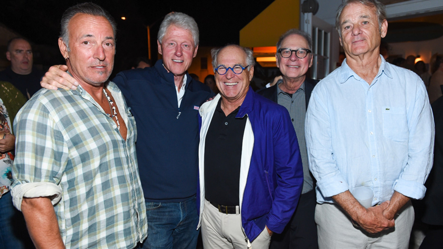 "Musican Bruce Springsteen, from left, former U.S President Bill Clinton, musician Jimmy Buffett,  screenwriter Barry Levinson, and actor Bill Murray attend the Hamptons Sneak Screening of Open Road Films' ""Rock the Kasbah"" after party on Friday, Aug. 28, 2015 in East Hampton, N.Y."
