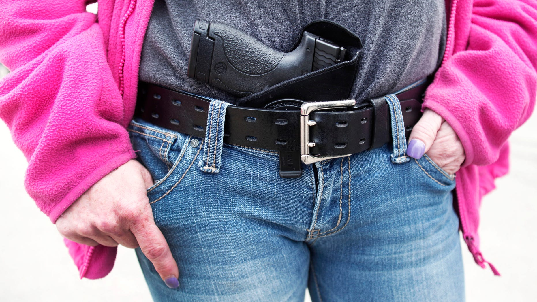Gloria Lincoln-Thompson of Garden City, Mich., carries her Smith & Wesson Shield 9mm pistol in her belt while participating in a rally and march supporting Michigan's Open Carry law April 27, 2014 in Romulus, Mich. (Getty Images)