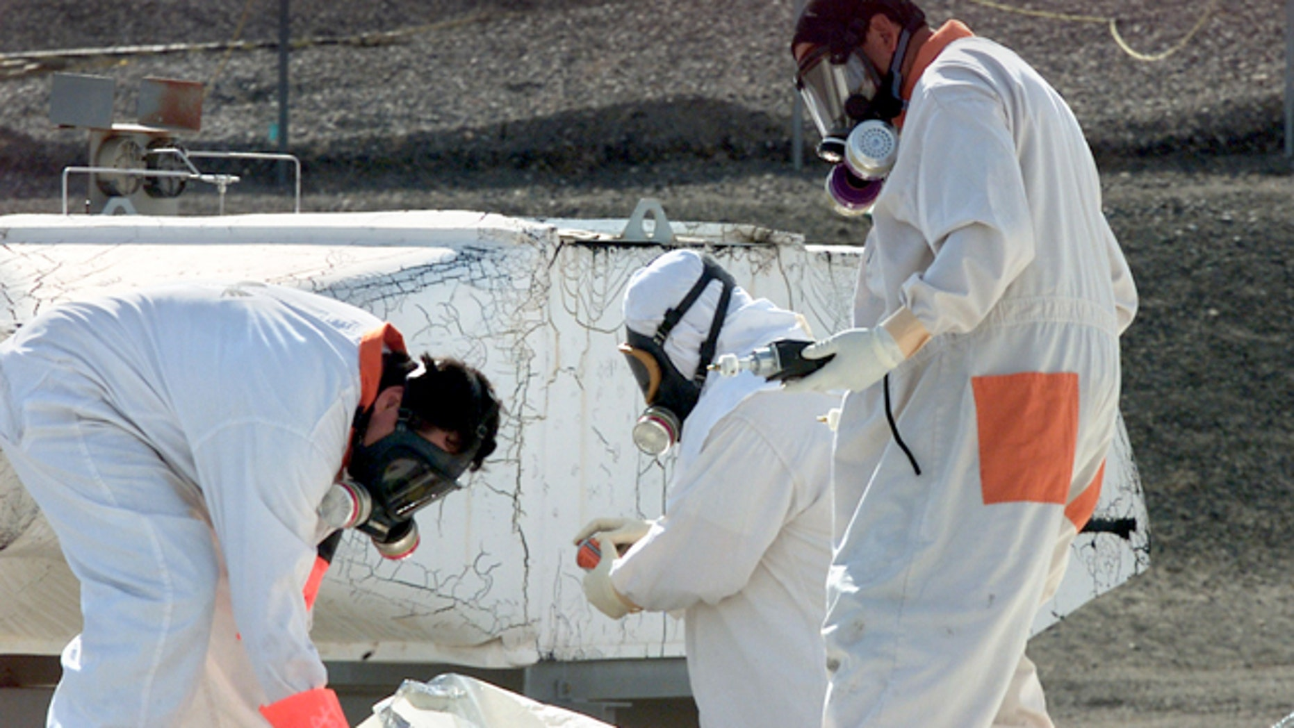 March 23, 2004: In this file photo, workers at the tank farms on the Hanford Nuclear Reservation near Richland, Wash., measure for radiation and the presence of toxic vapors.