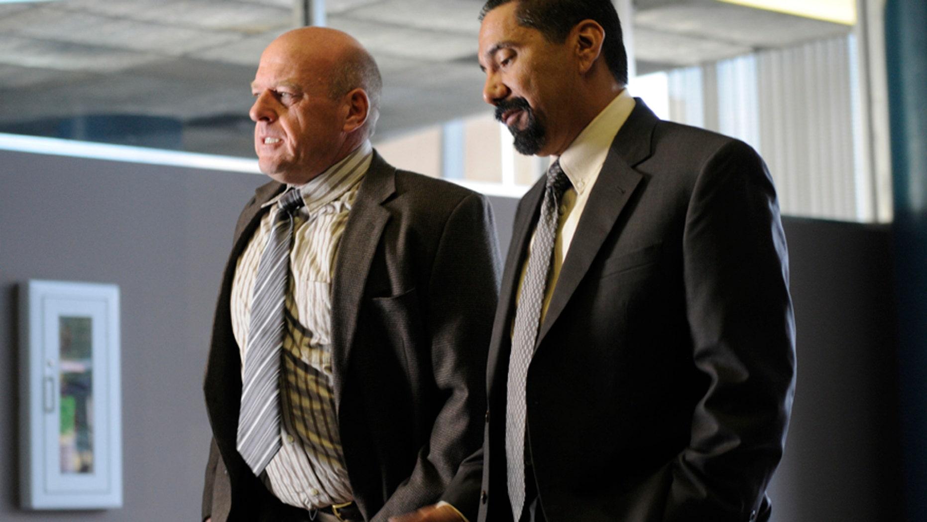 "Hank Schrader (Dean Norris) (left) and Steven Gomez (Steven Michael Quezada) (right) appear in an epsiode of AMC's ""Breaking Bad."""