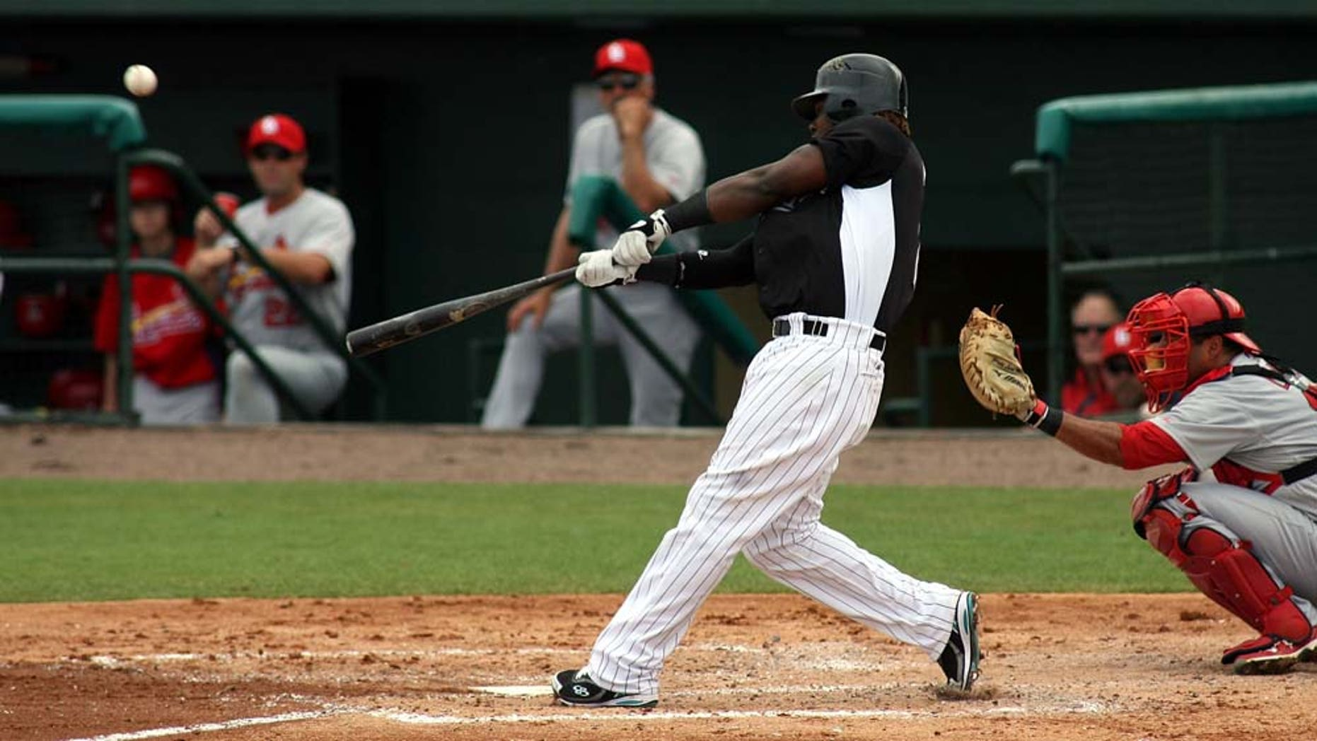 JUPITER, FL - MARCH 06:  Hanley Ramirez #2 of the Florida Marlins bats against the St. Louis Cardinals at Roger Dean Stadium on March 6, 2011 in Jupiter, Florida.  (Photo by Marc Serota/Getty Images)