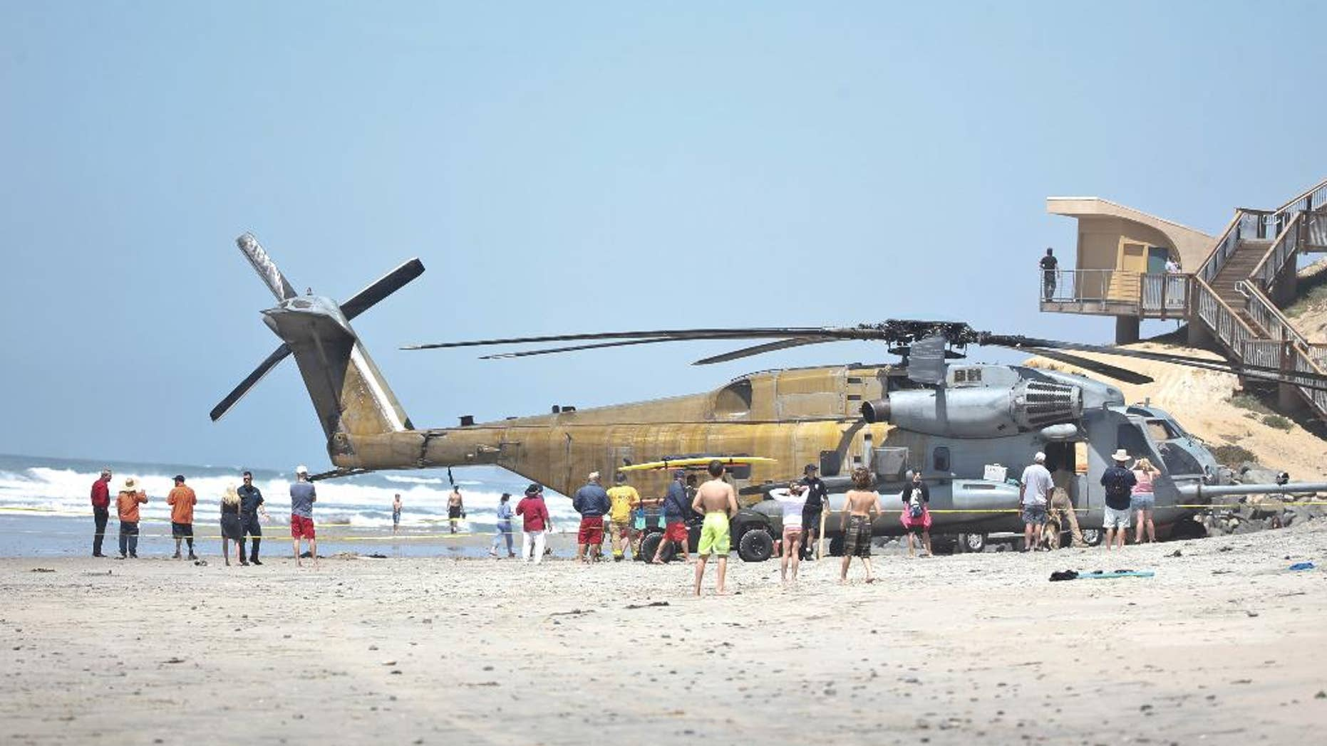 FILE -In this Wednesday, April 15, 2015 file photo, a Marine Corps CH-53E helicopter sits in the sand where it made an emergency landing in Solana Beach, Calif. One Marine has been killed and 9 others were hurt when a helicopter made a hard landing at Camp Lejeune in North Carolina, Wednesday night, Sept. 2, 2015. (AP Photo/Lenny Ignelzi, File)