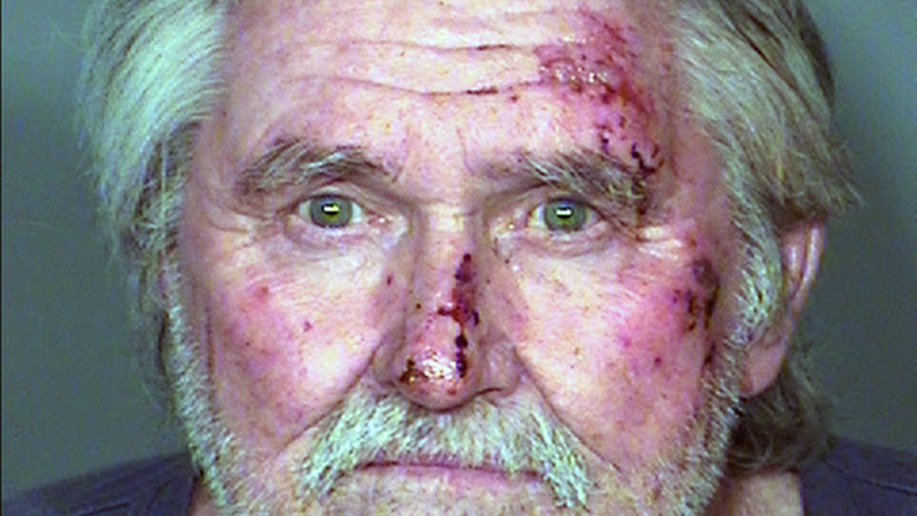 Feb. 2, 2015: This photo provided by the Las Vegas Metropolitan Police Department shows Larry Reid, the brother of U.S. Senate Democratic Leader Harry Reid. The Nevada Highway Patrol said that Larry Reid was arrested on misdemeanor driving under the influence, weapon, battery on an officer and other charges after he was found in a vehicle parked in a dirt median of a state highway. (AP Photo/Las Vegas Metropolitan Police Department)