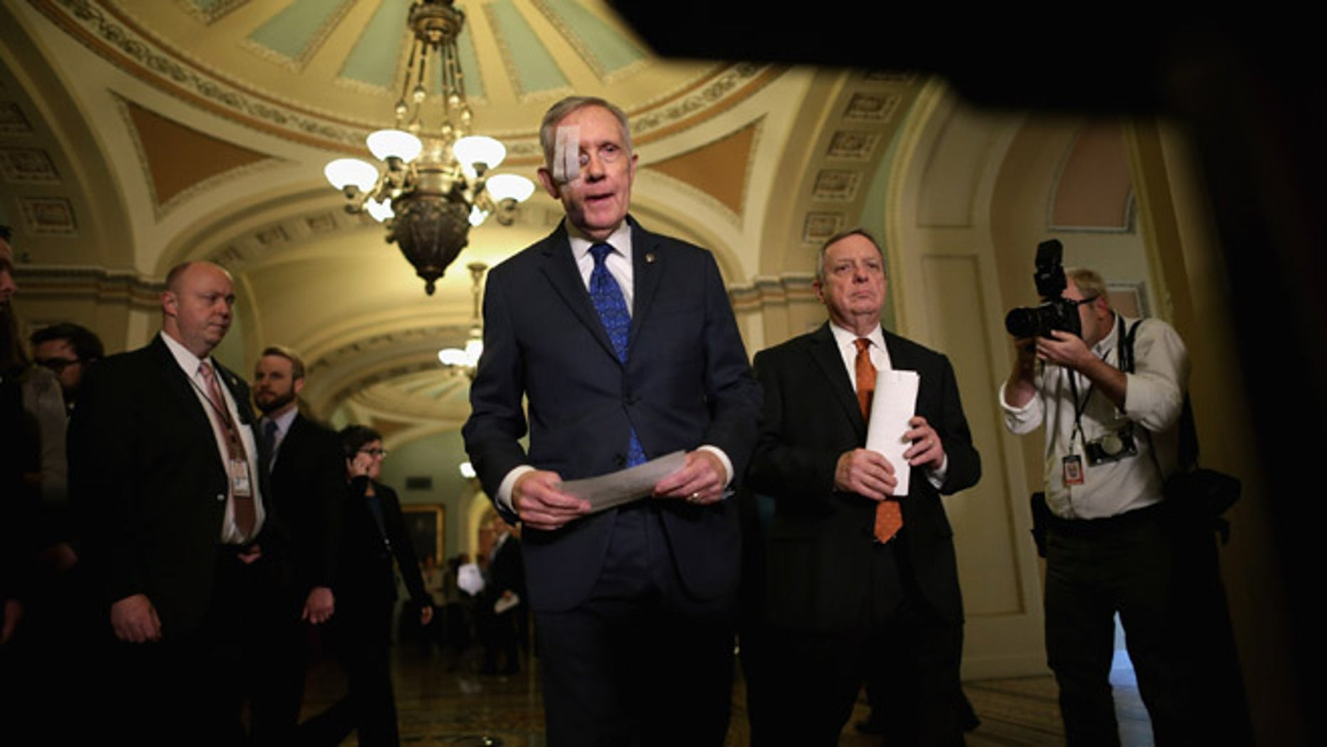 WASHINGTON, DC - FEBRUARY 03:  Senate Minority Leader Harry Reid (D-NV) (C) and Senate Minority Whip Richard Durbin (D-IL) (2nd R) arrive for a news conference after the weekly Democratic Senate policy luncheon at the U.S. Capitol February 3, 2015 in Washington, DC. Reid is wearing a bandage over his right eye after undergoing surgery to repair damage from an exercise accident.  (Photo by Chip Somodevilla/Getty Images)