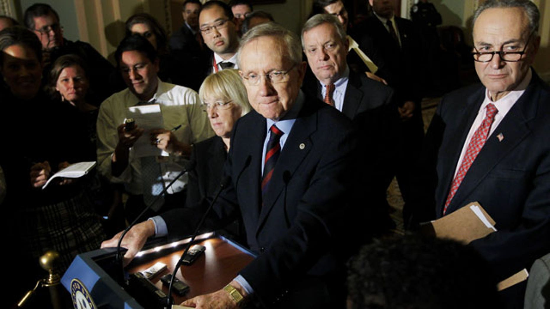 December 1, 2011: Senate Majority Leader Harry Reid of Nev., center, accompanied by Sen. Patty Murray, D-Wash., Senate Majority Whip Richard Durbin of Ill., and Sen. Charles Schumer, D-N.Y., speaks to reporters about extending the payroll tax cut on Capitol Hill in Washington.