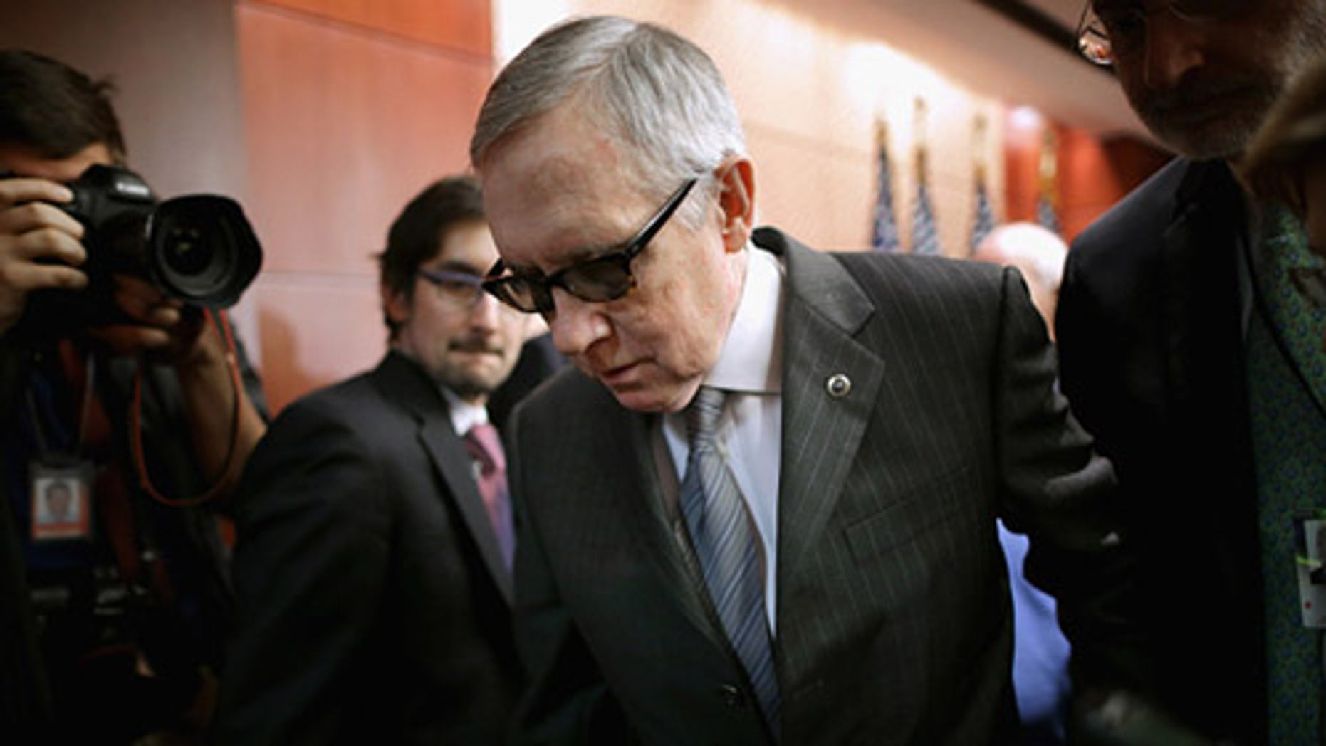 WASHINGTON, DC - FEBRUARY 24:  Senate Minority Leader Harry Reid (D-NV) leaves a news conference where he accused Republican Senate leaders of manufacturing the possible shutdown of the Department of Homeland Security at the U.S. Capitol February 24, 2015 in Washington, DC. Democrats have successfully blocked the $39.7 billion funding legislation because it would also strip away the executive actions in which President Barack Obama eased the deportation threat for several million undocumented immigrants. If Republicans and Democrats can not work around the impasse then 30,000 DHS employees will go home February 28 and 200,000 more will work without paychecks until a solution is found.  (Photo by Chip Somodevilla/Getty Images)