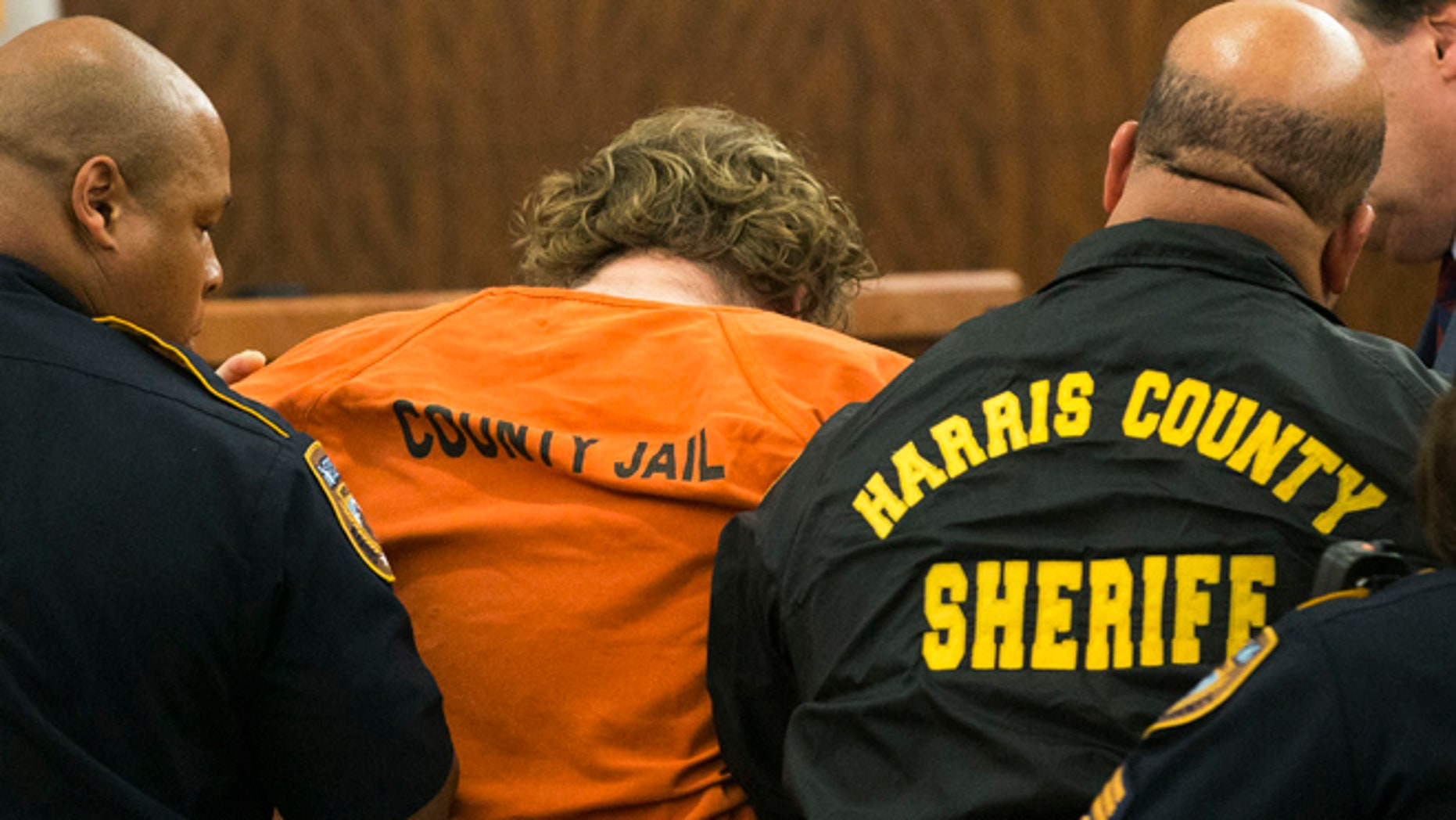 July 11: Ronald Lee Haskell collapses as he appears in court in Houston.  Haskell, 33, is accused of killing his ex-wife's sister, Katie Stay, her husband and the children, ranging in age from 4 to 14, after binding and putting them face-down on the floor of their suburban Houston home.