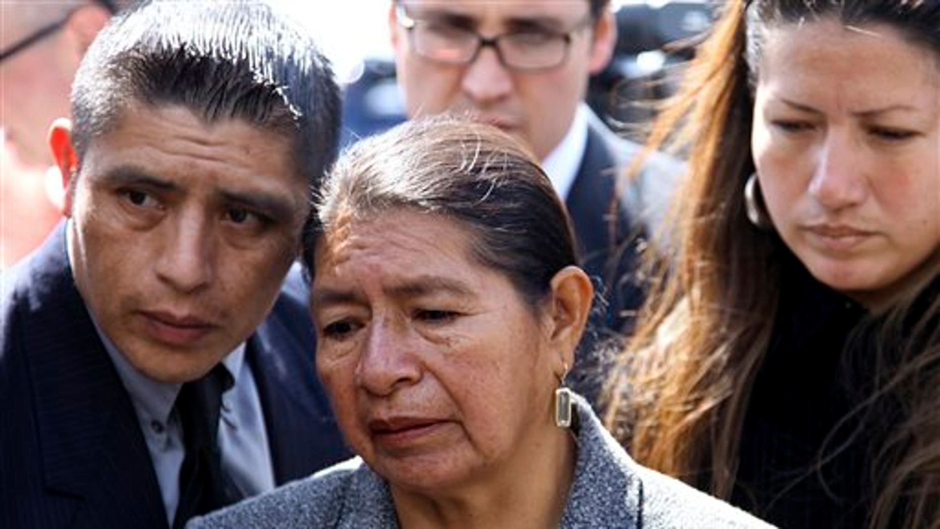 April 19, 2010: Rosario Lucero, center, her son Joselo and daughter Isabel stand near the site where her son Marcelo Lucero was stabbed to death in Patchogue, N.Y.