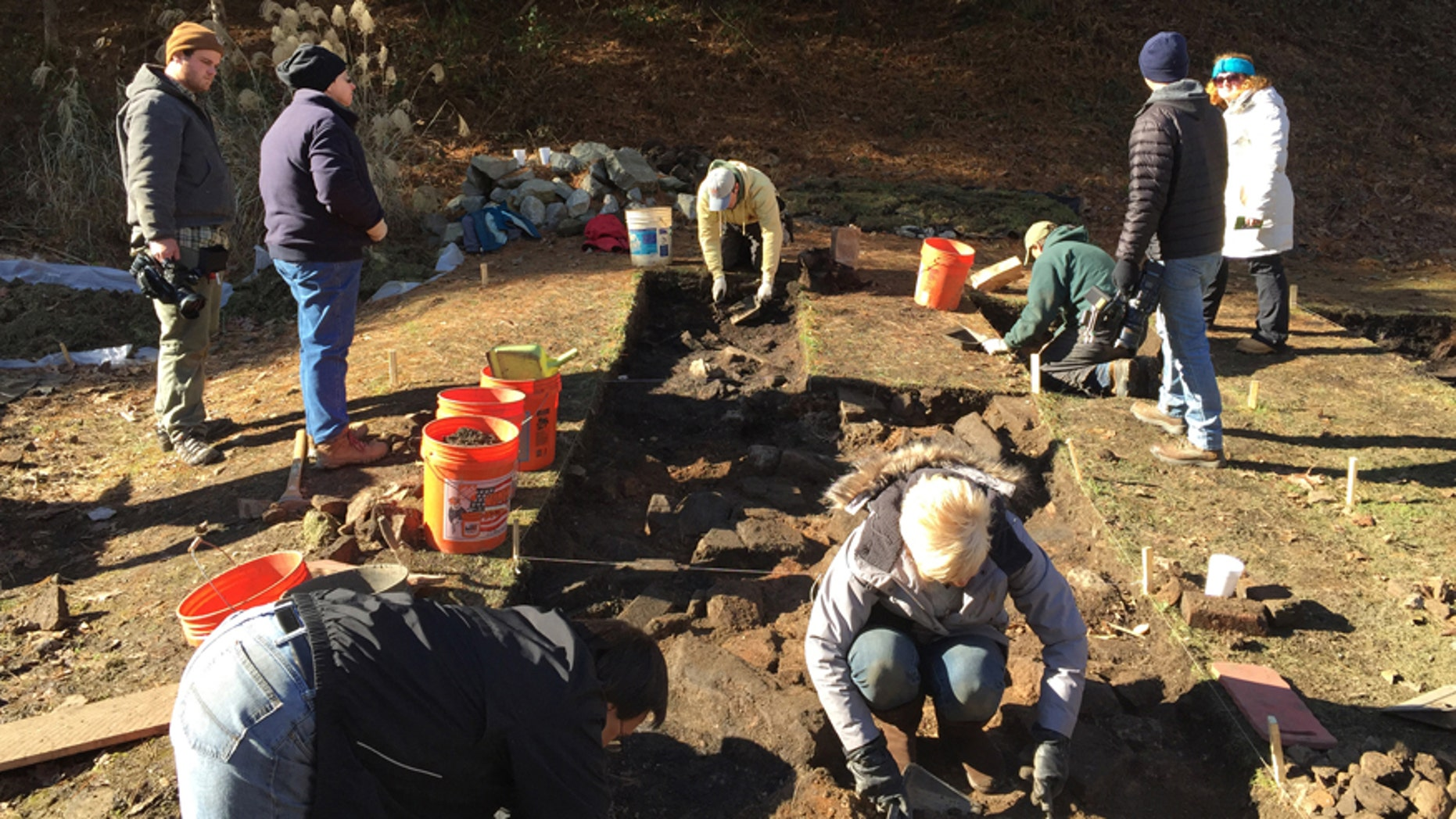 This Nov. 19, 2014 photo made available by Bill Richardson, shows the descendants of the Hatfield and McCoy families clearing the homesite of Randall McCoy in Pike County, KY.