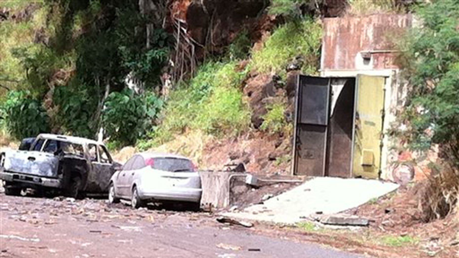 April 8: This image provided by KITV shows the entrance to the bunker where fireworks were stored at Waikele Business Center in Waipahu, Hawaii. At least two men were killed, injuring two others and two are missing after the explosion. (AP/KITV)