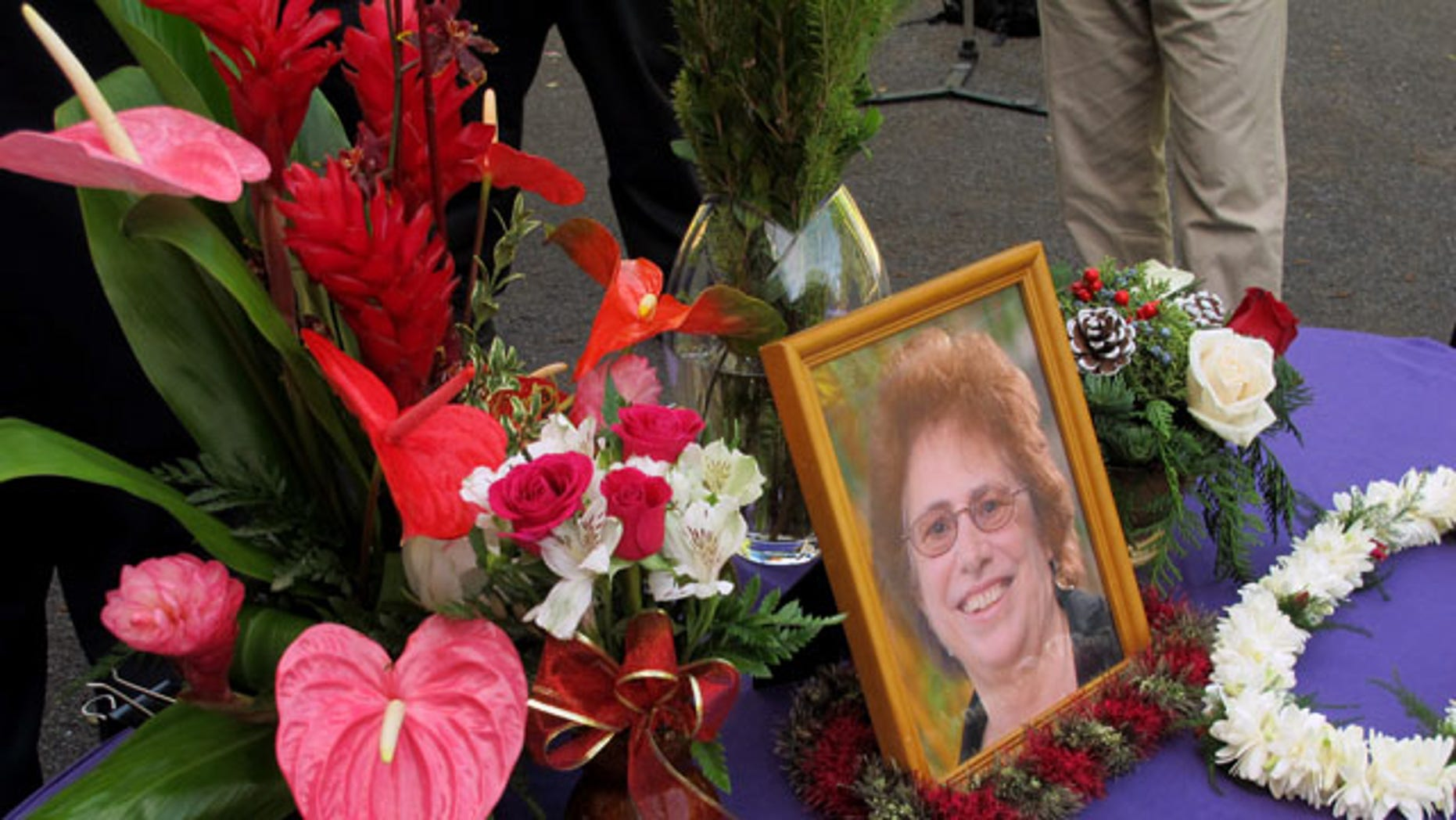 FILE - In this Dec. 12, 2013 file photo, a memorial for Loretta Fuddy, the director of the state Department of Health, is displayed outside the department in Honolulu. (AP)