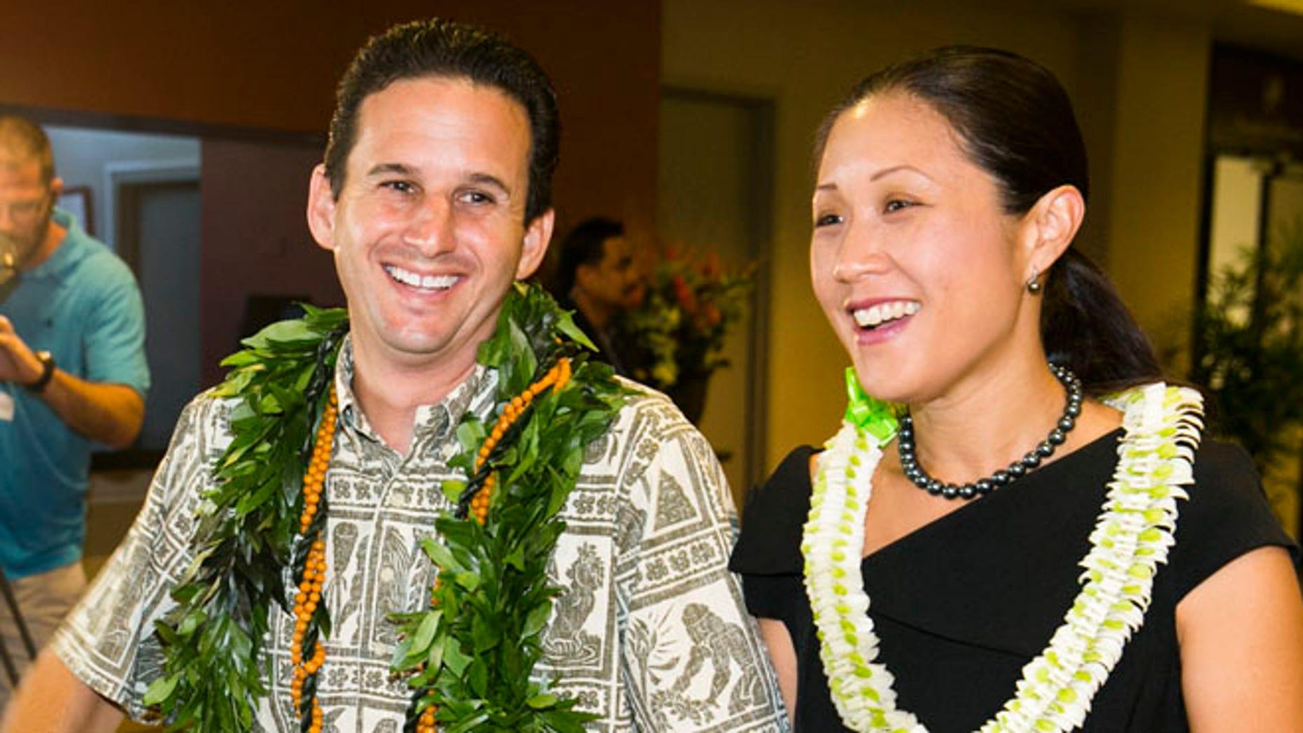 US Sen. Brian Schatz, left, and Linda Kwok Schatz attend the Democratic Unity Breakfast, Sunday, Aug. 10, 2014 in Honolulu.