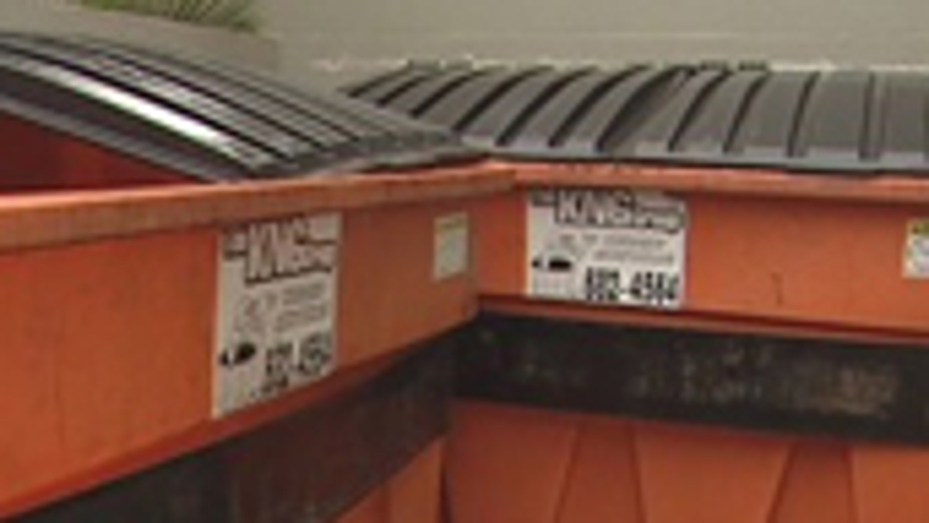 Mar. 12, 2012: Police search for clues after a child's fingers were found in this dumpster in Hawaii.