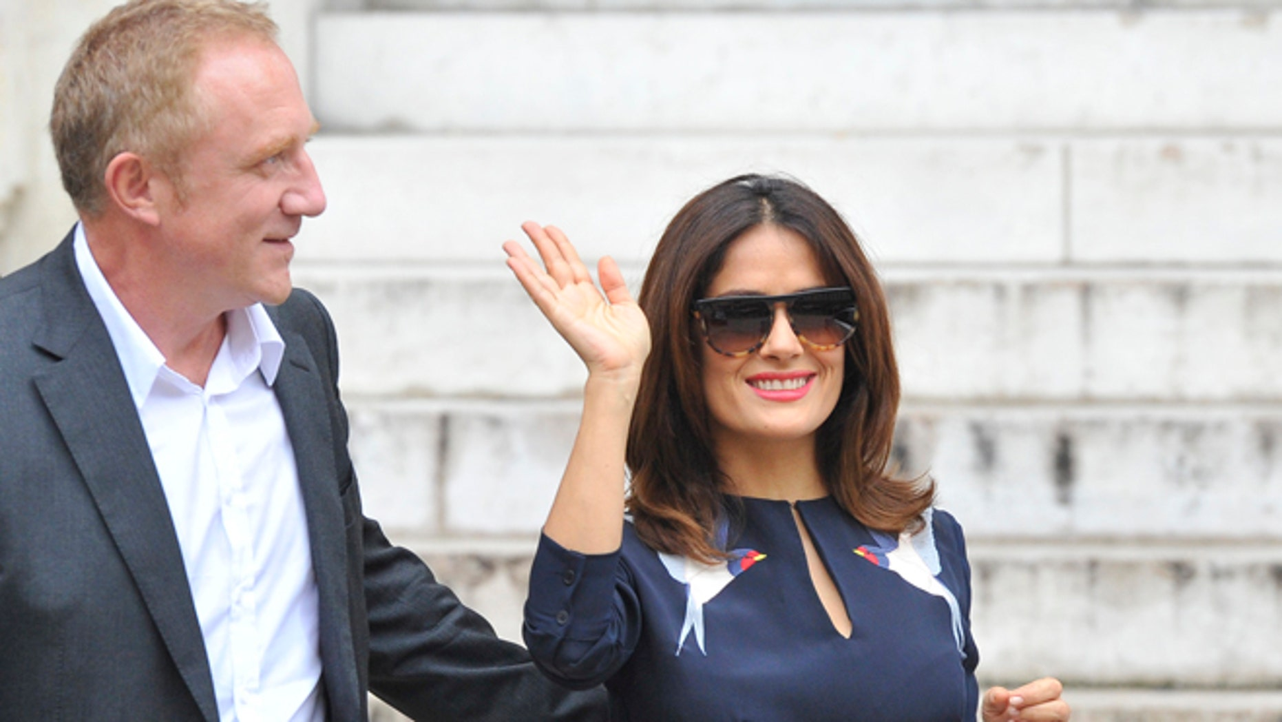 19a7b7f267 Mexican actress Salma Hayek waves as her husband Francois-Henri Pinault