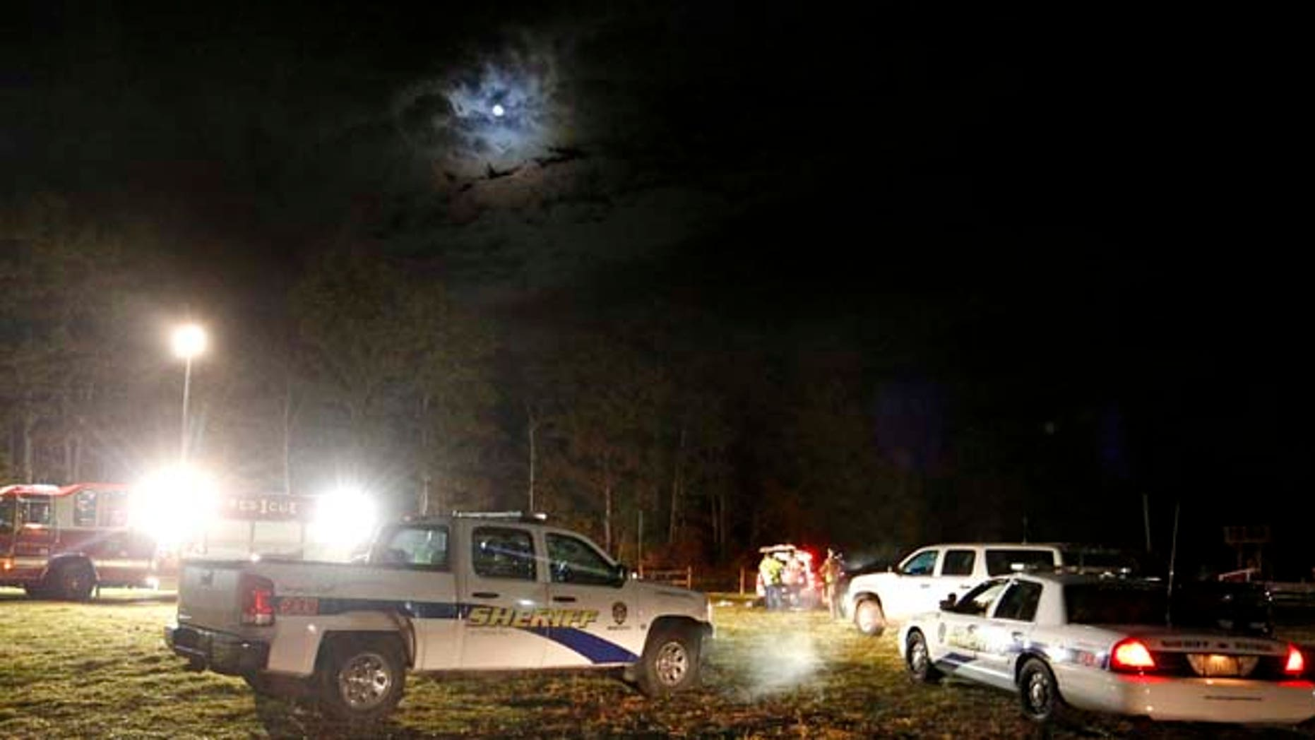 Oct. 11, 2014: Emergency personnel work at the site of a hayride rollover that injured multiple people Harvest Hill Farms in Mechanic Falls on Route 126.  (AP/Maine Today, Gabe Souza)