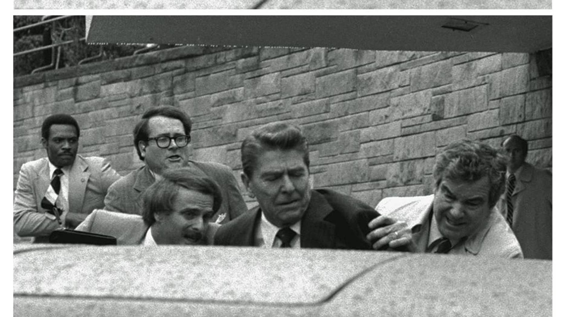 FILE - In this March 30, 1981 black-and-white three picture combo file photo, President Reagan waves, then looks up before being shoved into Presidential limousine by Secret Service agents after being shot outside a hotel in Washington. The last man to shoot an American president now spends most of the year in a house overlooking the 13th hole of a golf course in a gated community. He takes long walks along tree-lined paths, plays guitar and paints, grabs fast food at Wendy's. He drives around town in a silver Toyota Avalon, a car that wouldn't attract a second glance. Often, as if to avoid detection, he puts on a hat or visor before going out. (AP Photo/Ron Edmonds, File)